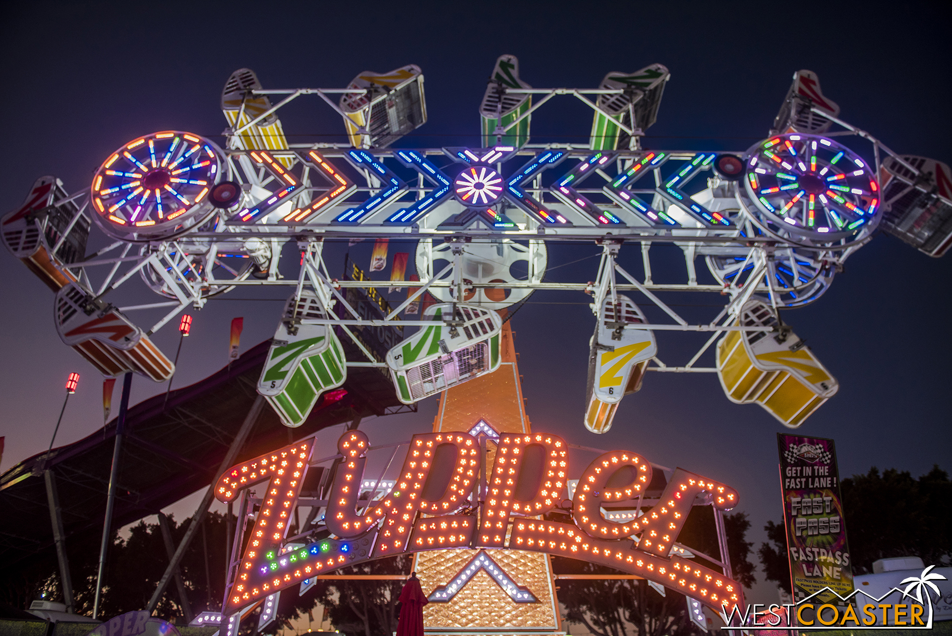 The Fair shines at night, though not brightly enough to mask the absurdity of what I still consider to be the freakiest attraction at the Fair.