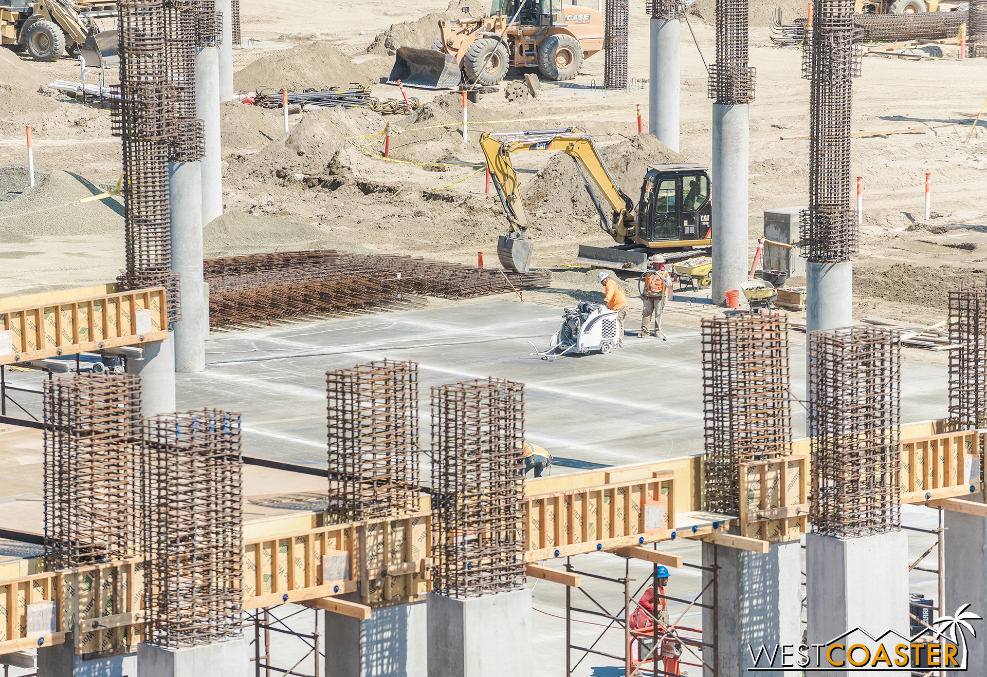 The ground floor is getting vehicular concrete in some areas too.  This guy was cutting control joints scored into the ground.