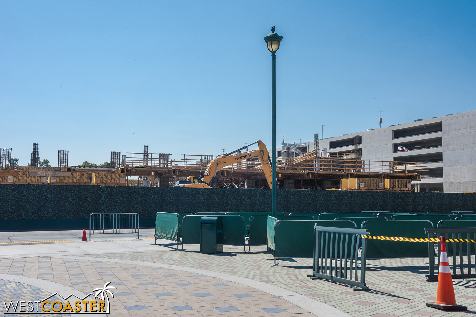 From ground level, the structure is rising above the construction fencing.