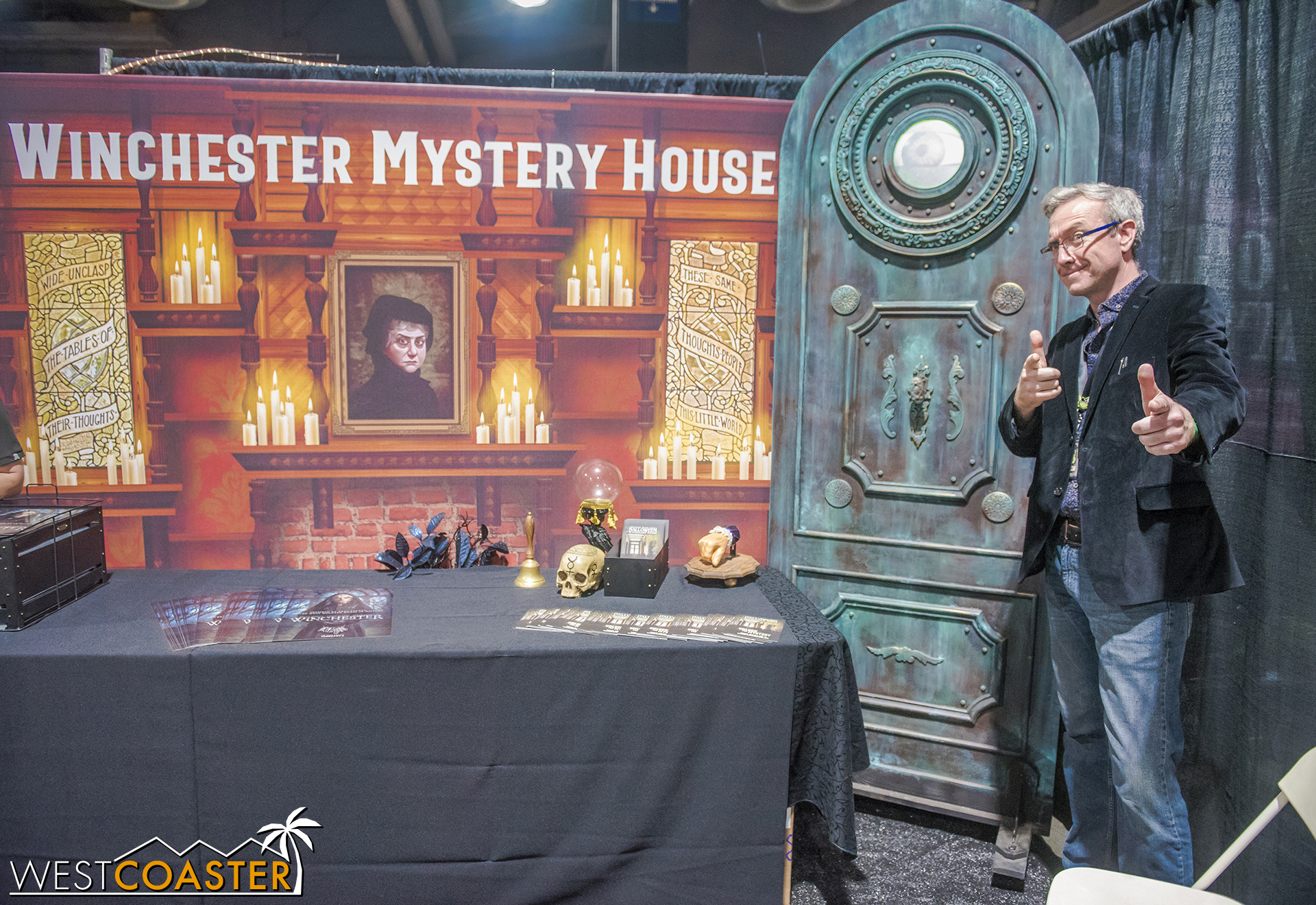 Winchester Mystery House creative director, Peter Overstreet, striking a pose in front of the Winchester booth.