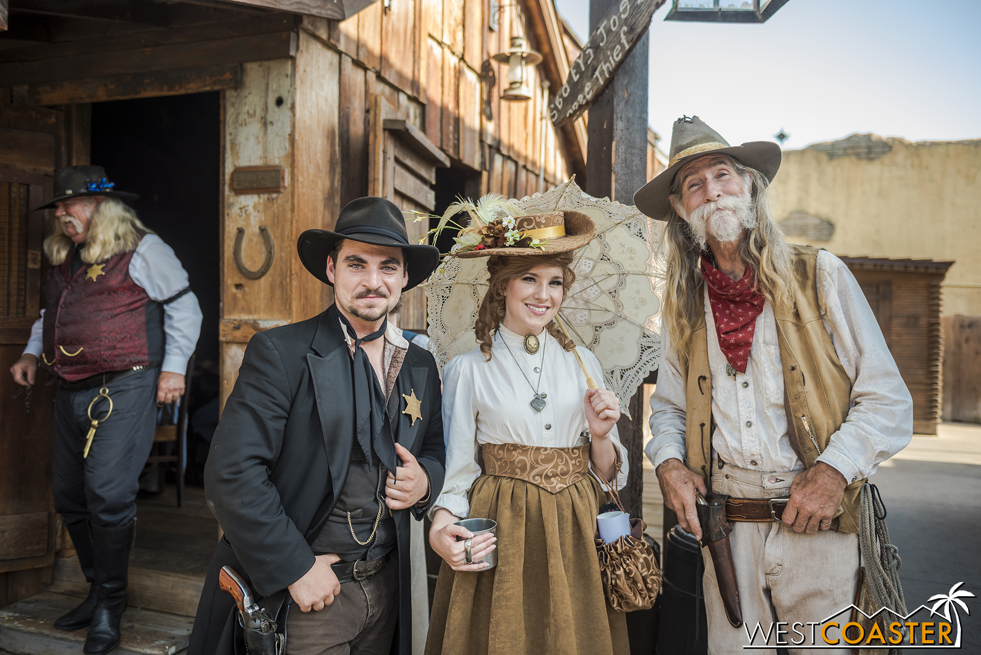 With the Mayfield Gang as a whole causing less trouble this year than usual, Deputy Luke, Goldie's Place manager, Violet Lee, and Ike Mayfield are able to pose together for a photo.