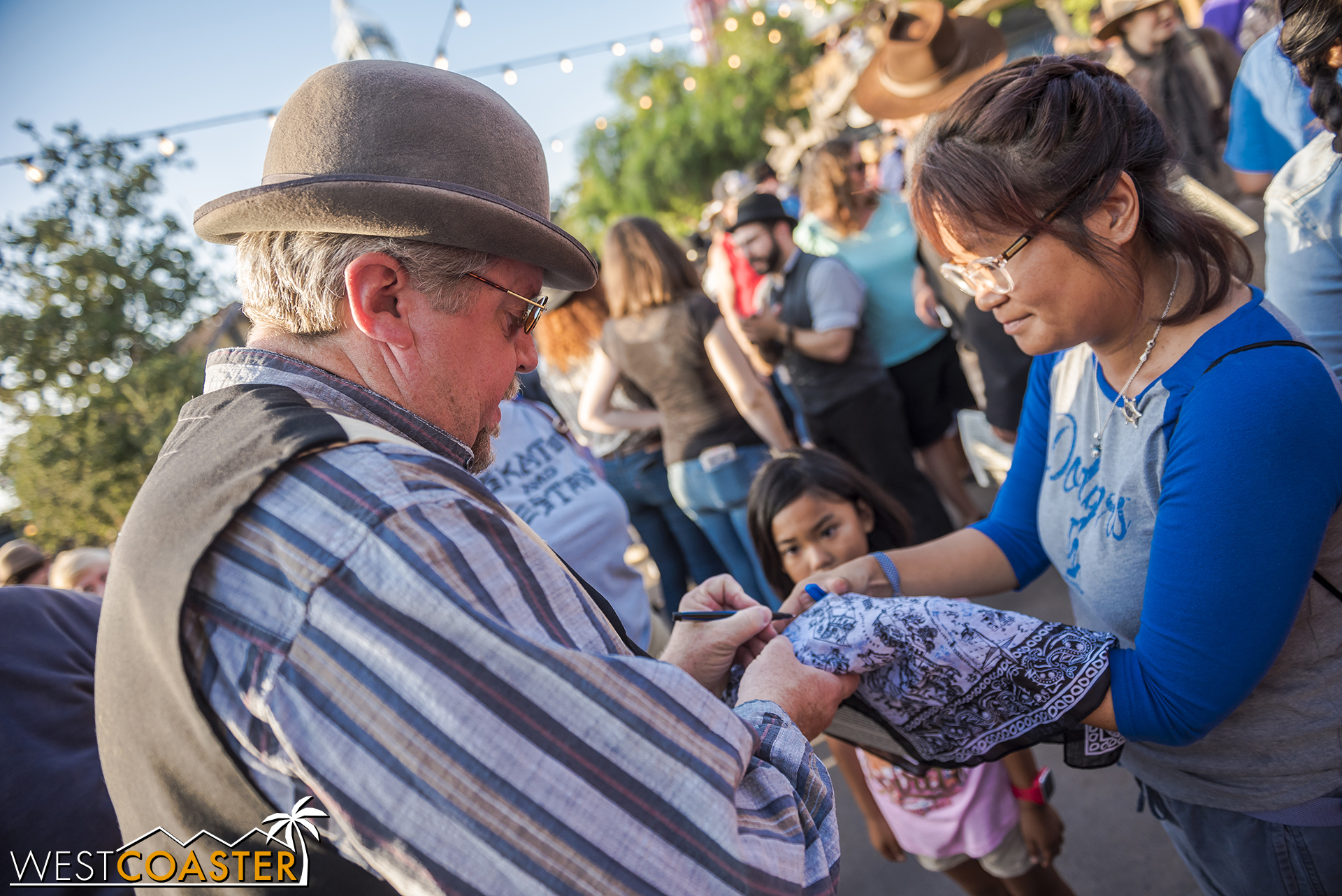Others have Knott's Ghost Town Alive! merchandise signed for keepsakes.