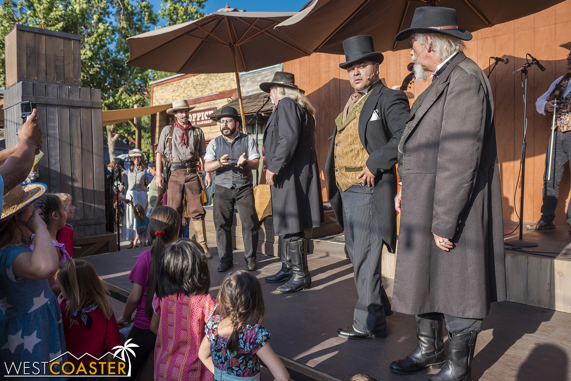 The festivities are interrupted, though, when Sheriff Wheeler announces the results of his investigation into the mysterious clues left in town have implicated a mastermind suspect.