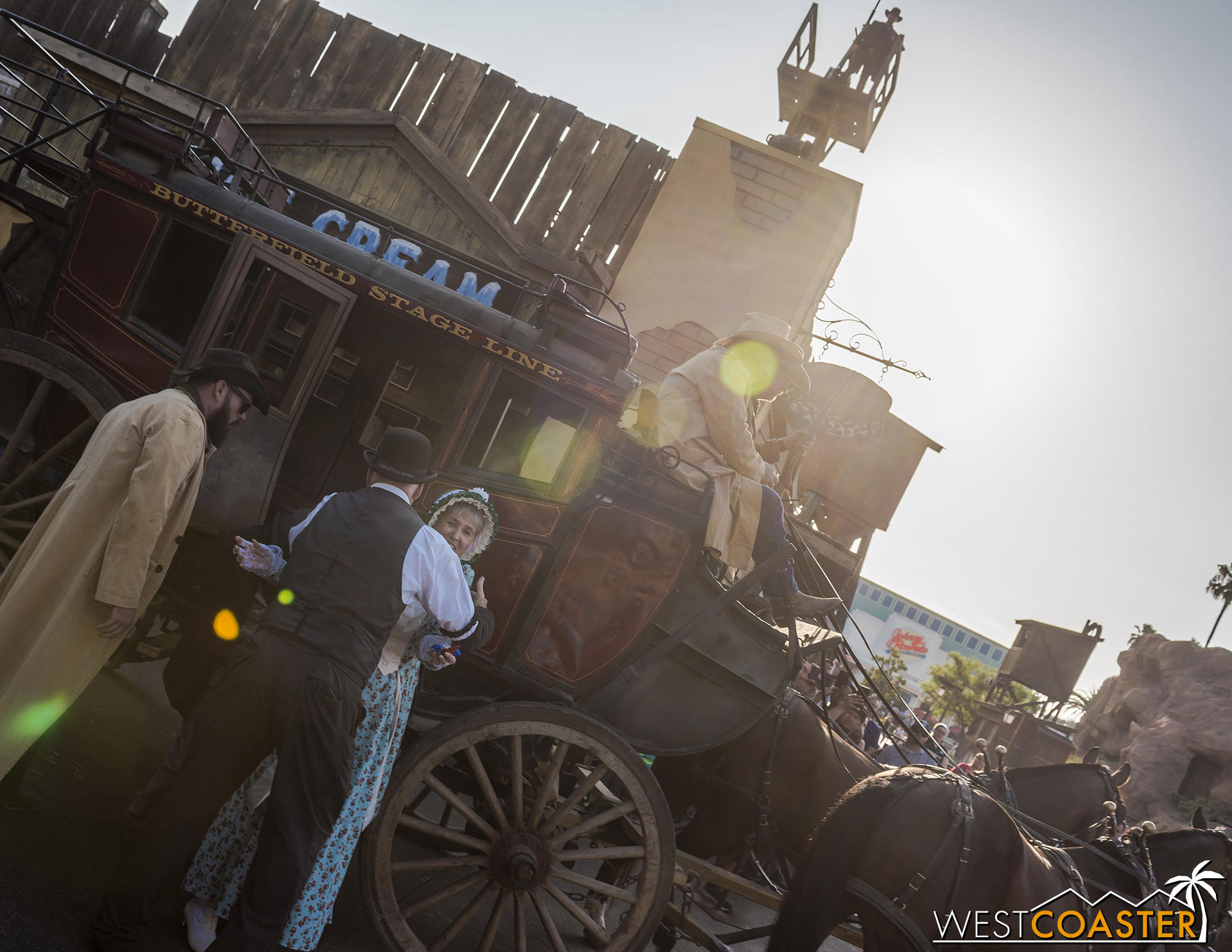 After Goldie West disembarks, Zeke embraces his wife, getting off the stagecoach.