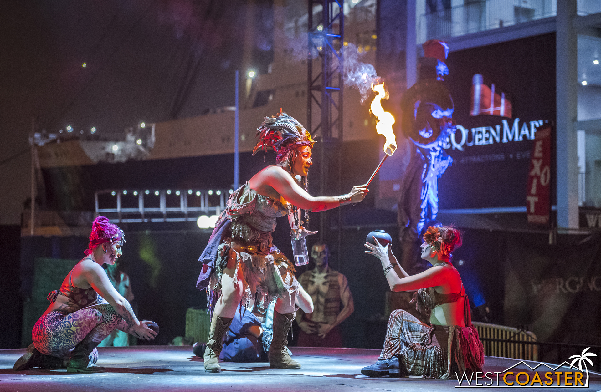 The Voodoo Priestess bequeaths fire to various performers.