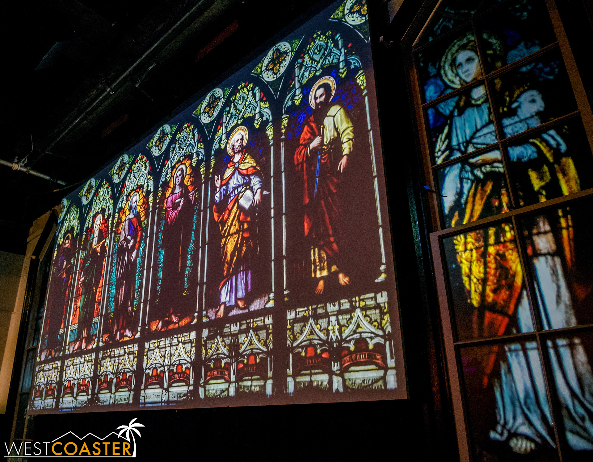 The stained glass becomes the cinema screen once the attraction begins.