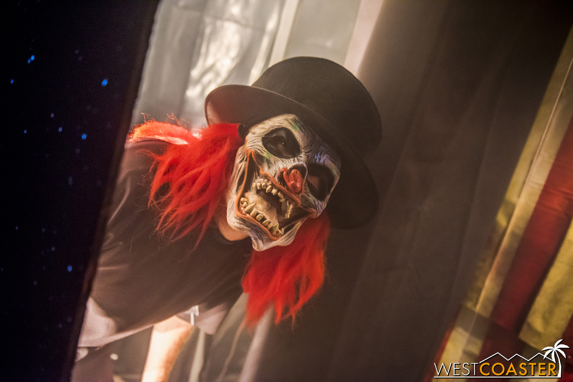 A killer clown greets guests as they enter, but not necessarily at the angle guests think!