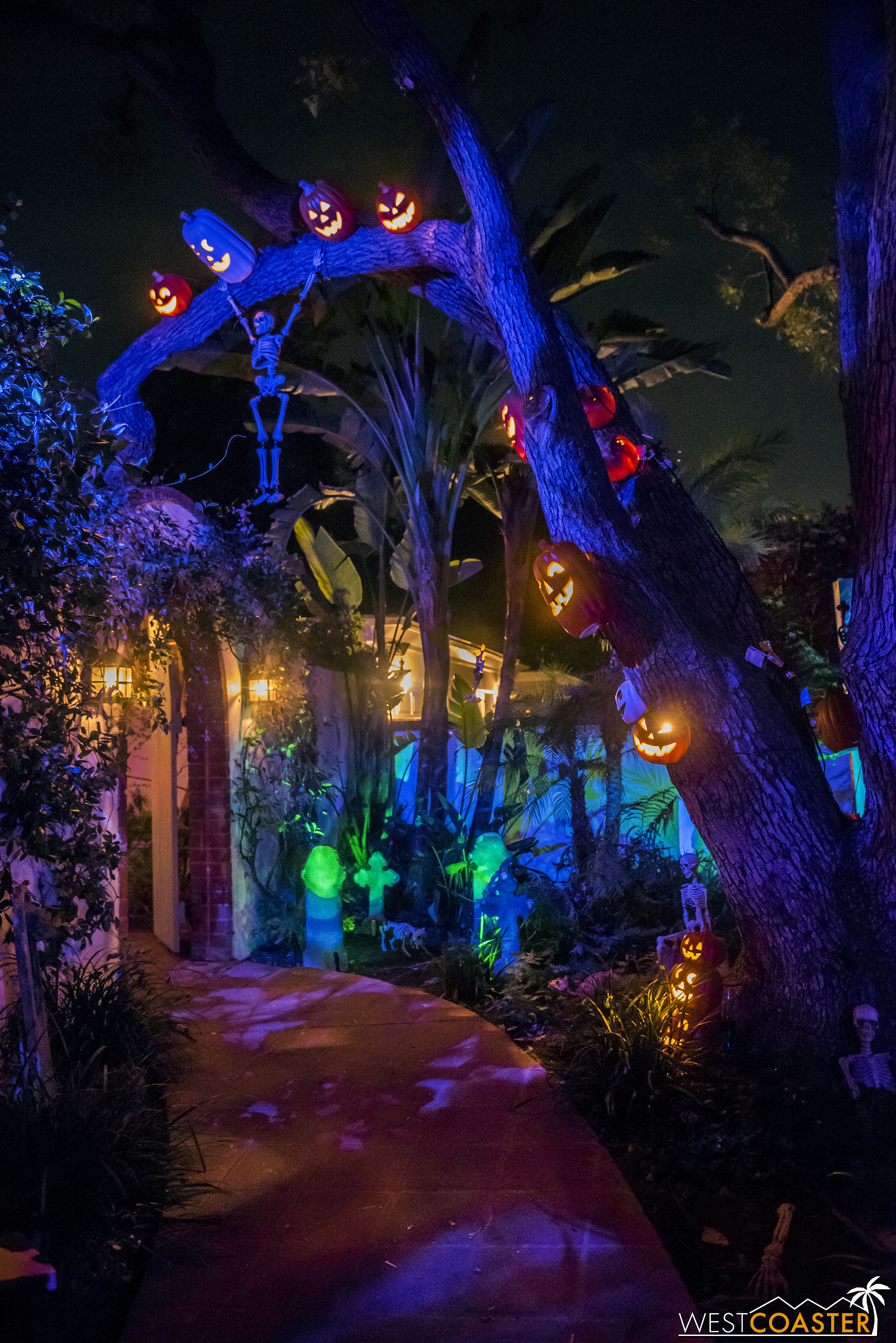 A lovely walkway leads to Pumpkin Hollow and the home's entry courtyard.