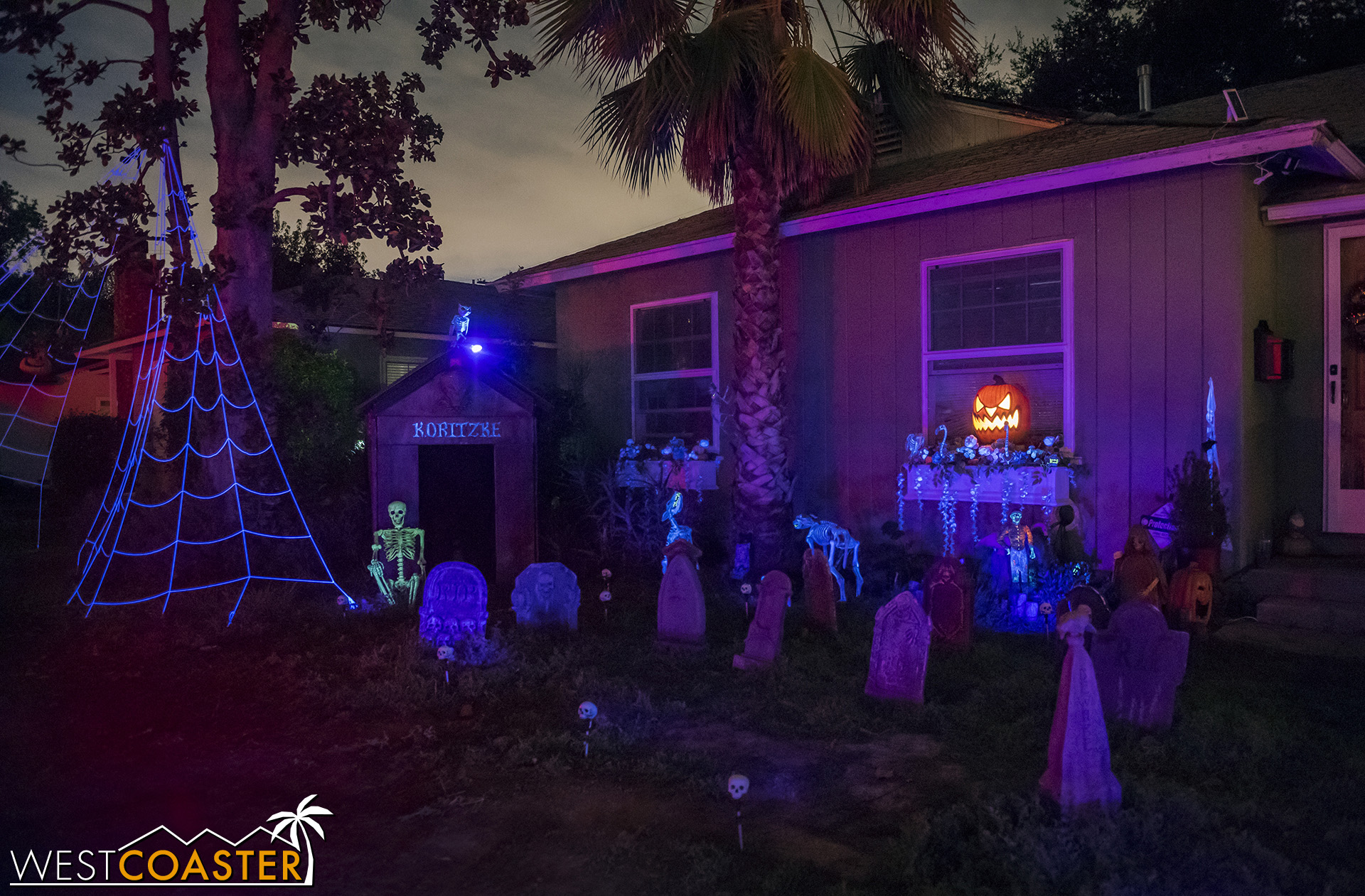 A creepy cemetery scene marks the front yard.