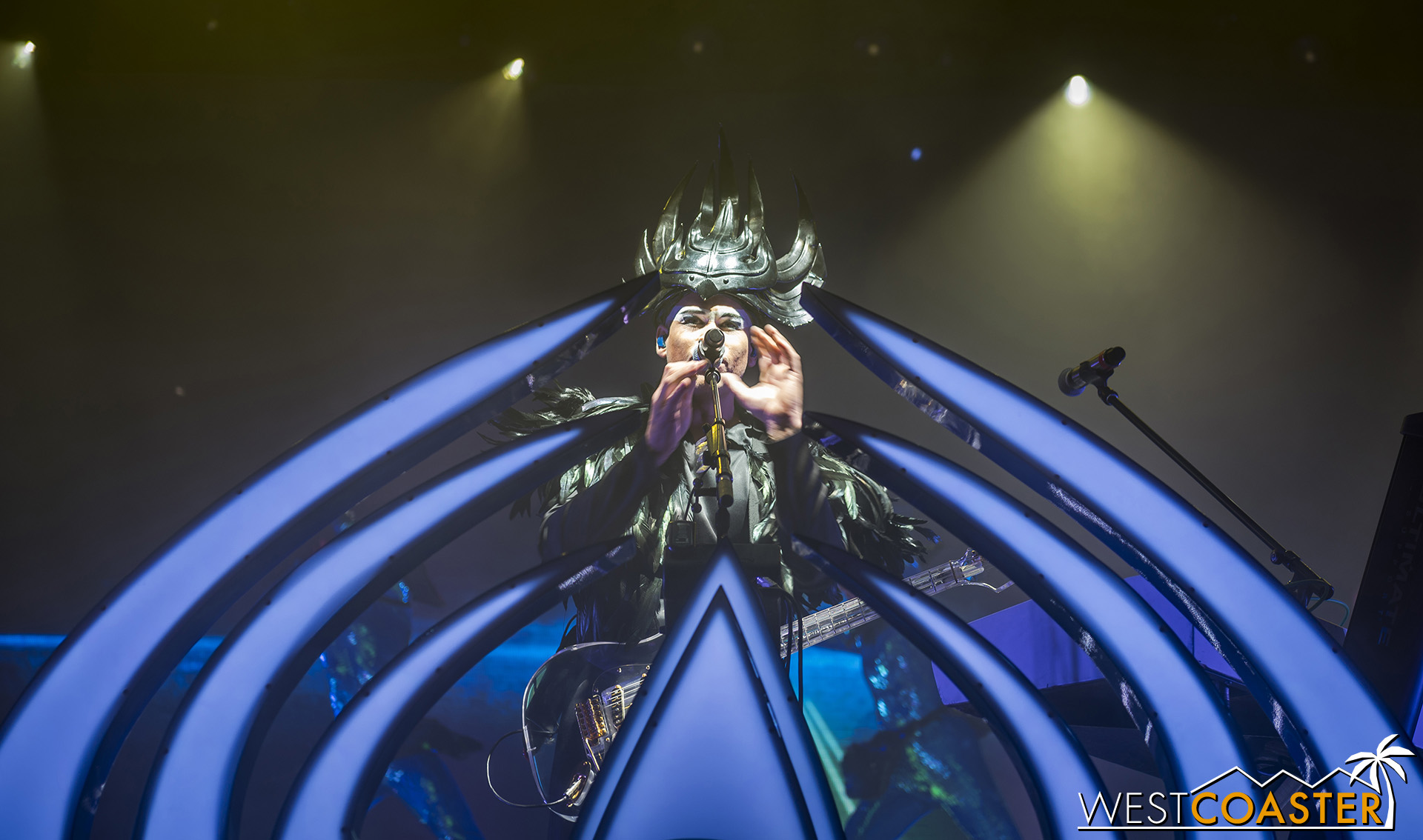 Vocalist, Luke Steele, front and center and in full regalia with Empire of the Sun.