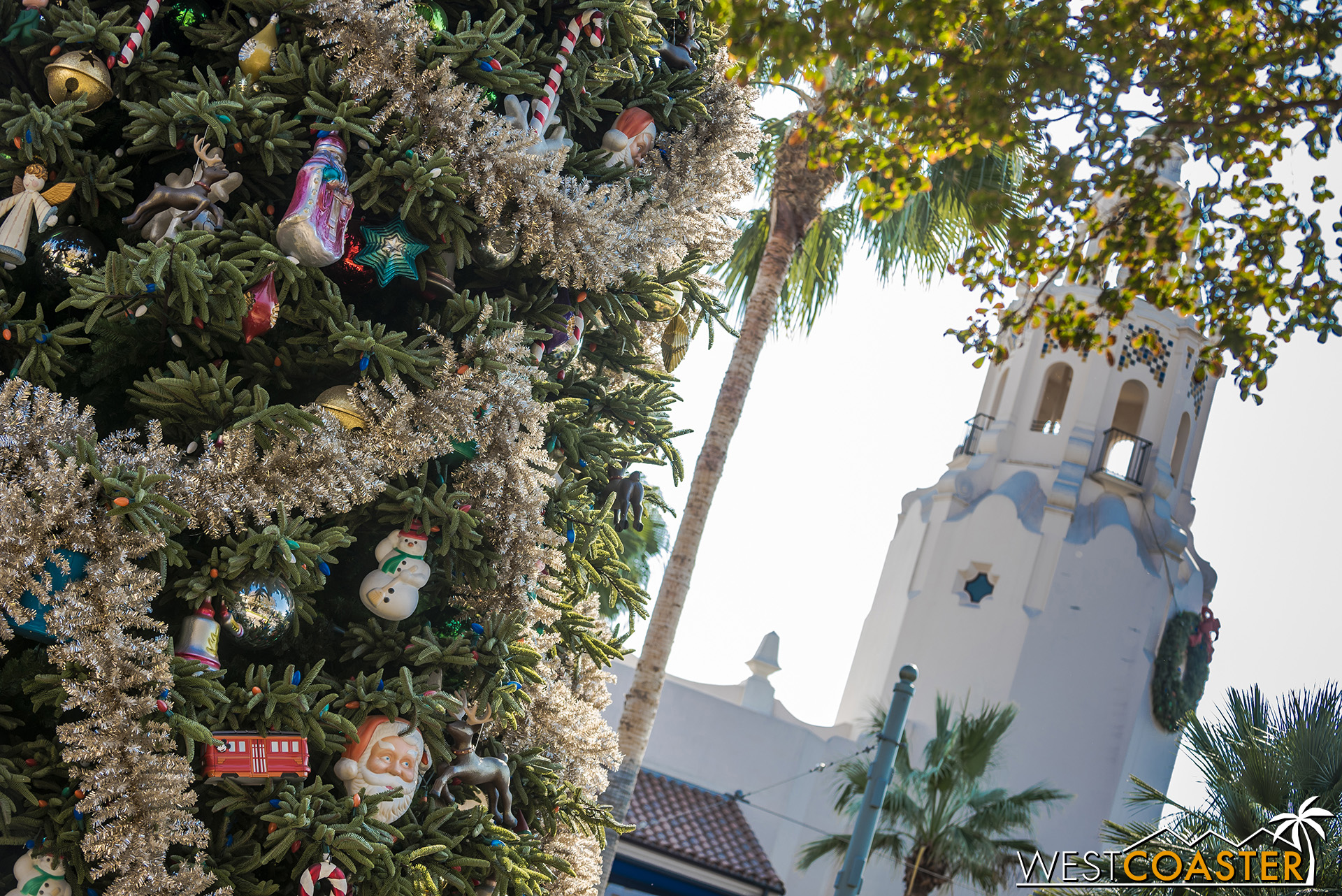 The towering Christmas tree is once again visible throughout Buena Vista Street.