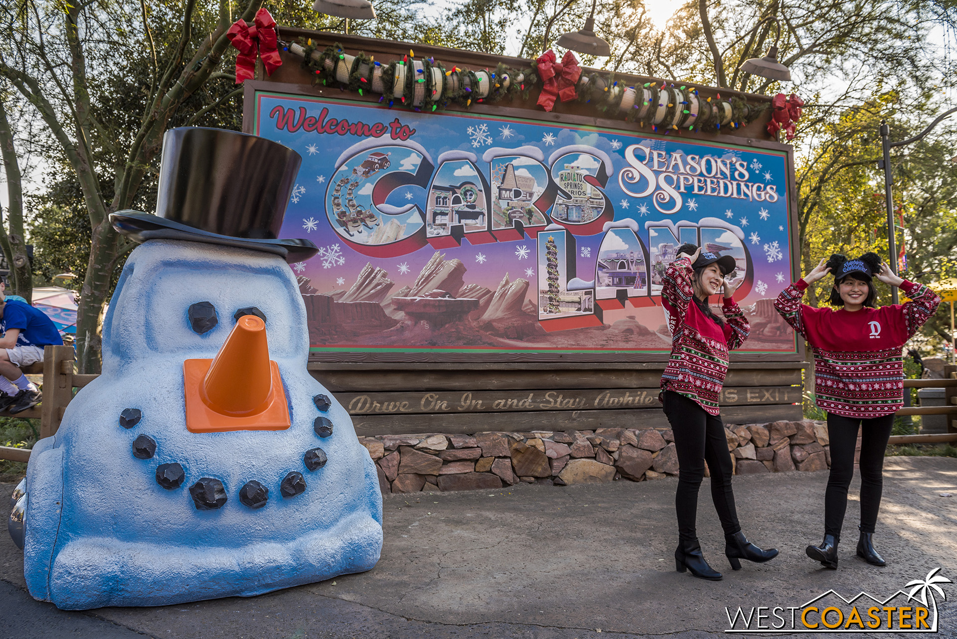 The Cars Land billboard has a seasonal overlay and is still attracting plenty of tourists.