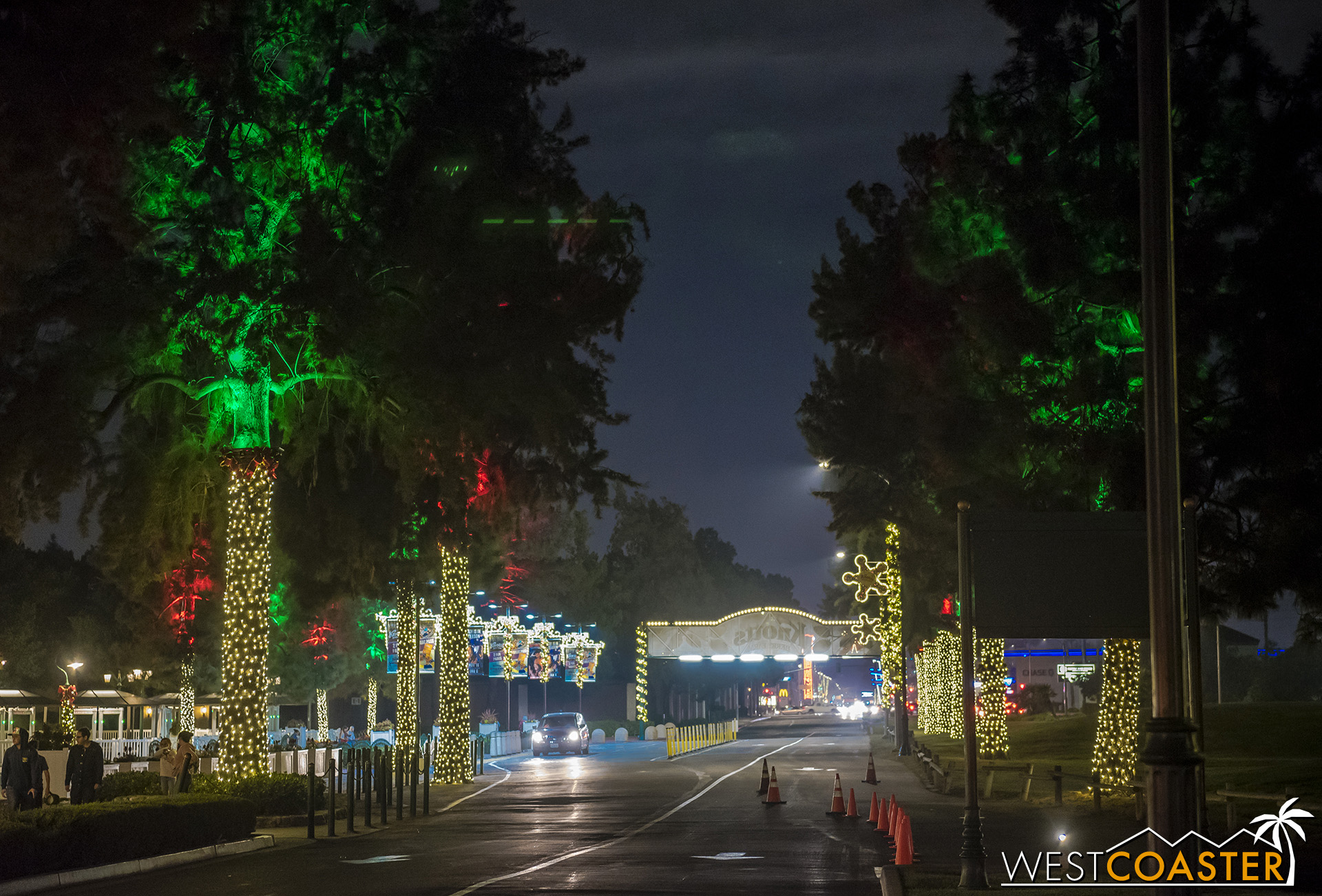 The expanded lighting presence can be seen immediately upon entering the Knott's Resort area, in the form of light-wrapped trees lining Grand Avenue.