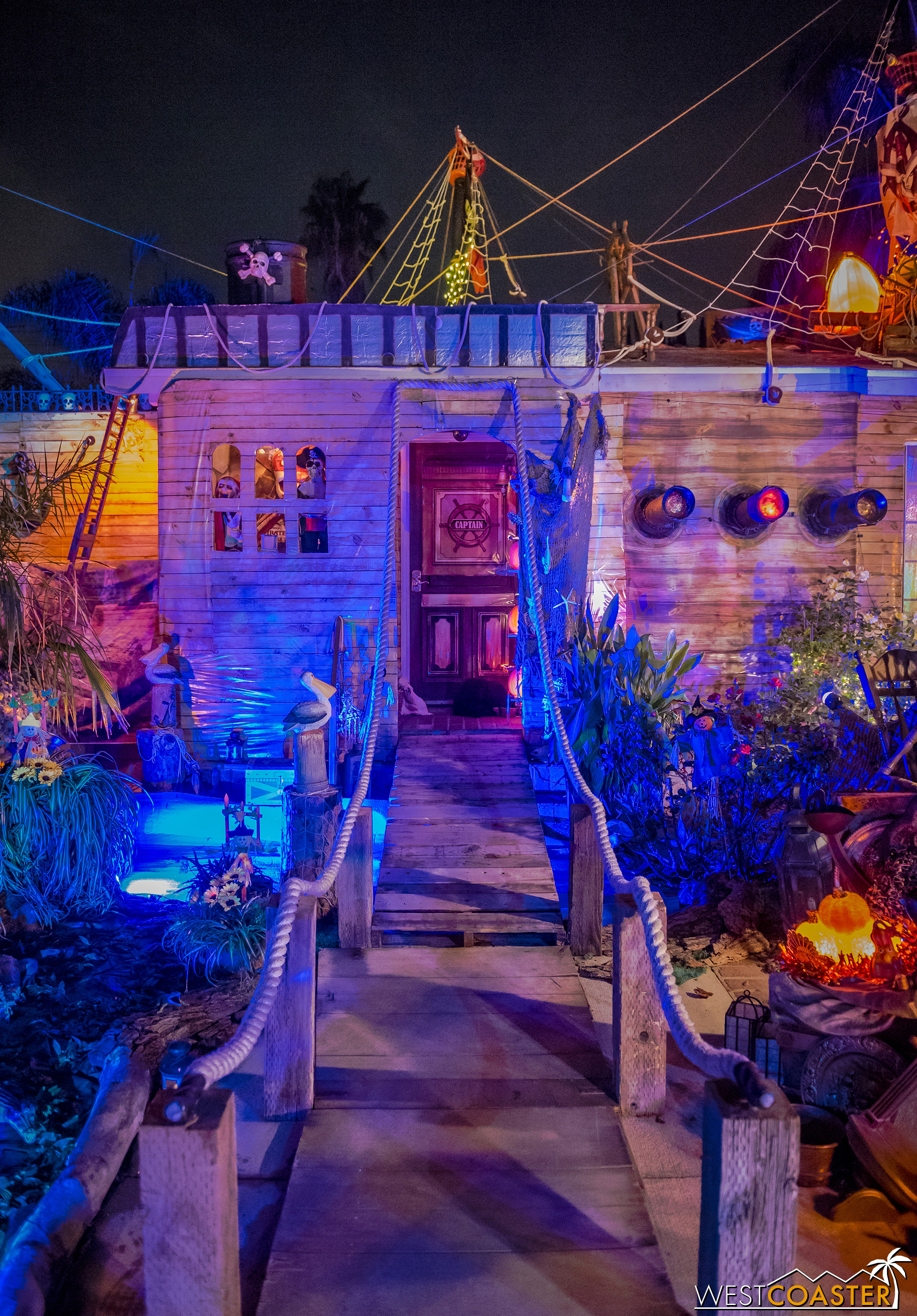 The entry door into the house is just about the only element recognizable from a residence in this amazing yard display.