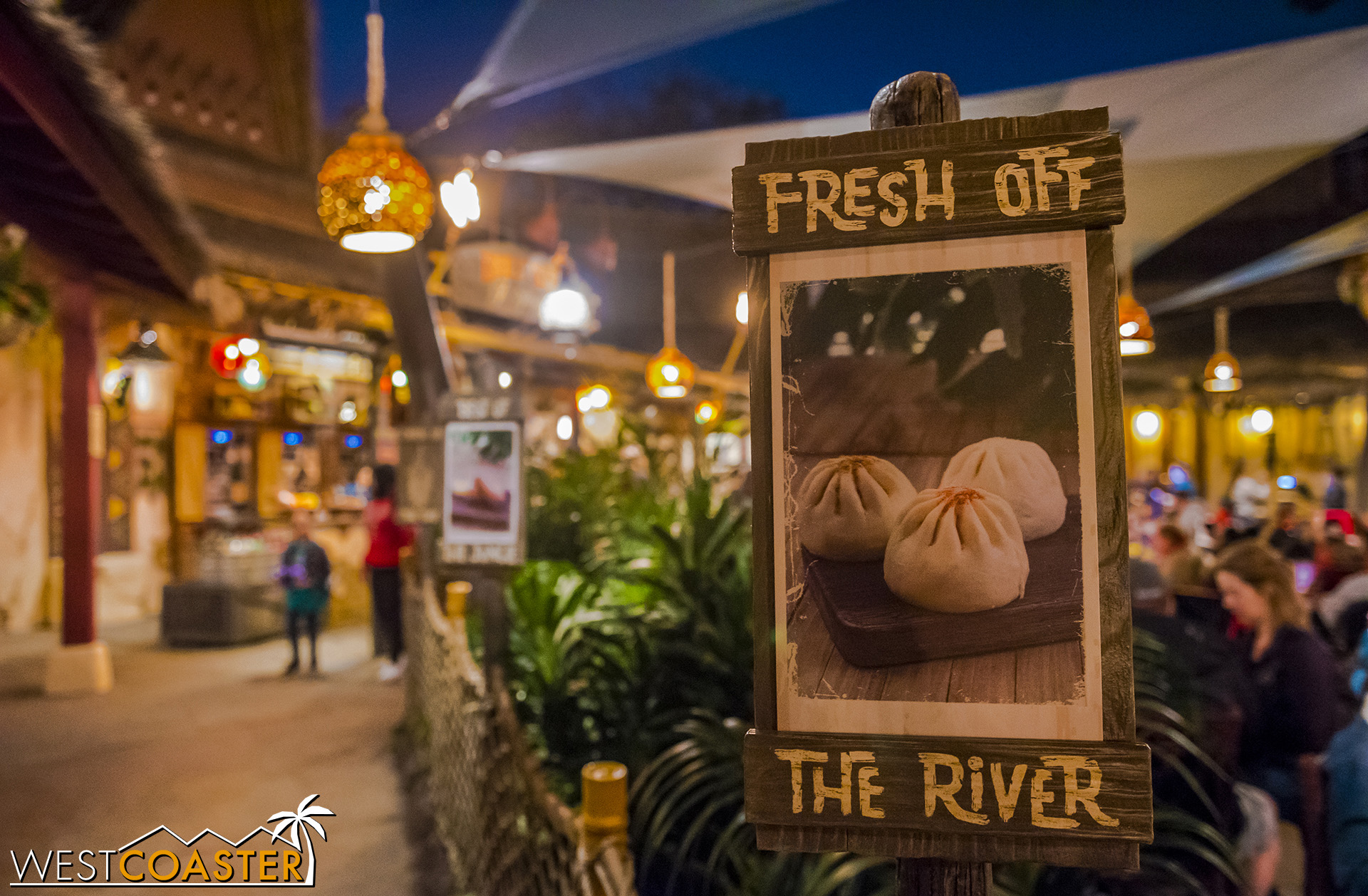 Heading into the food queue, guests are greeted by some signage promising delectable bites to be had.