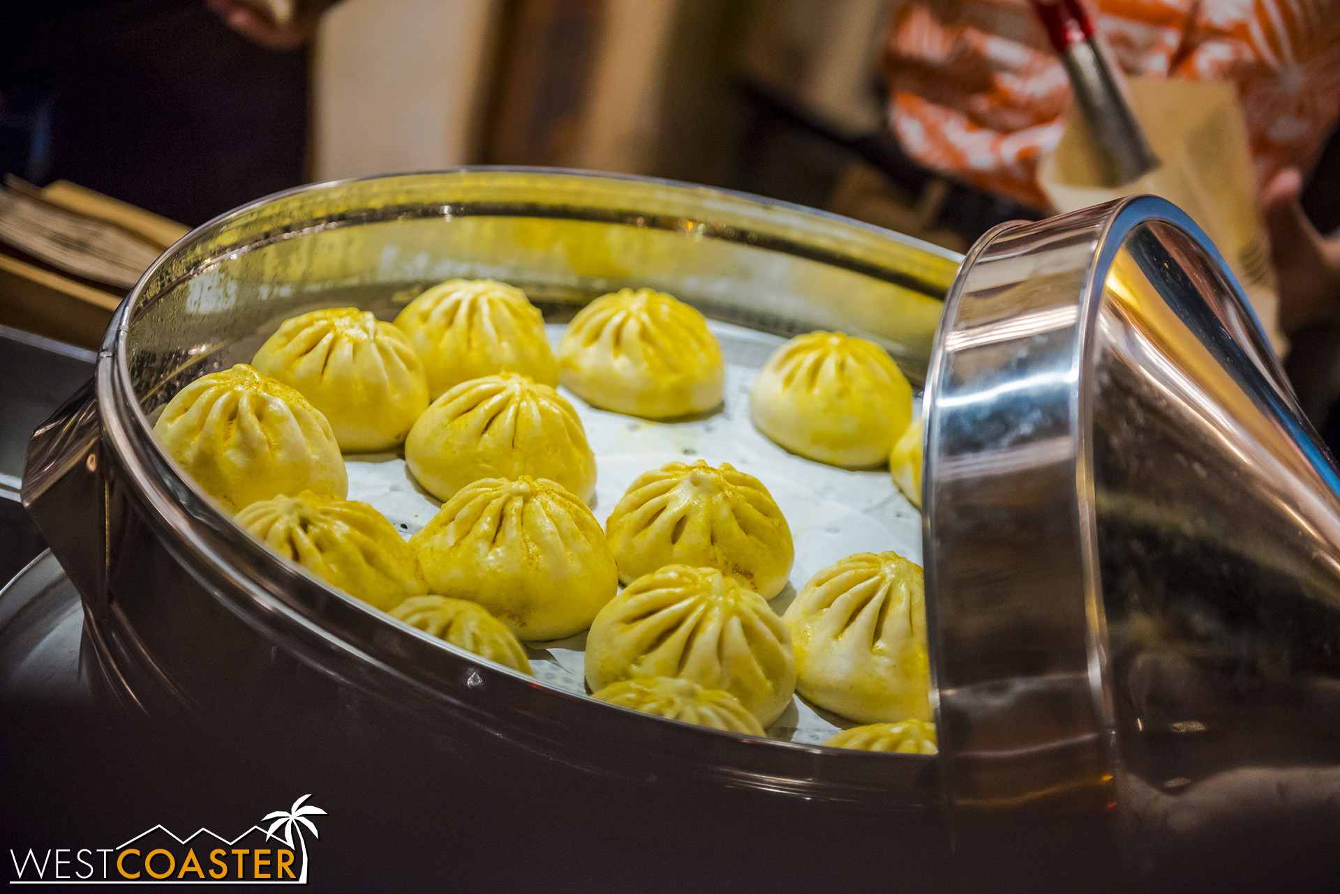 These are the Lime Chicken Baos, with butternut squash and fresh herbs, characterized by their yellow exterior.  The beef is red on top, and the vegetable buns are not colored.