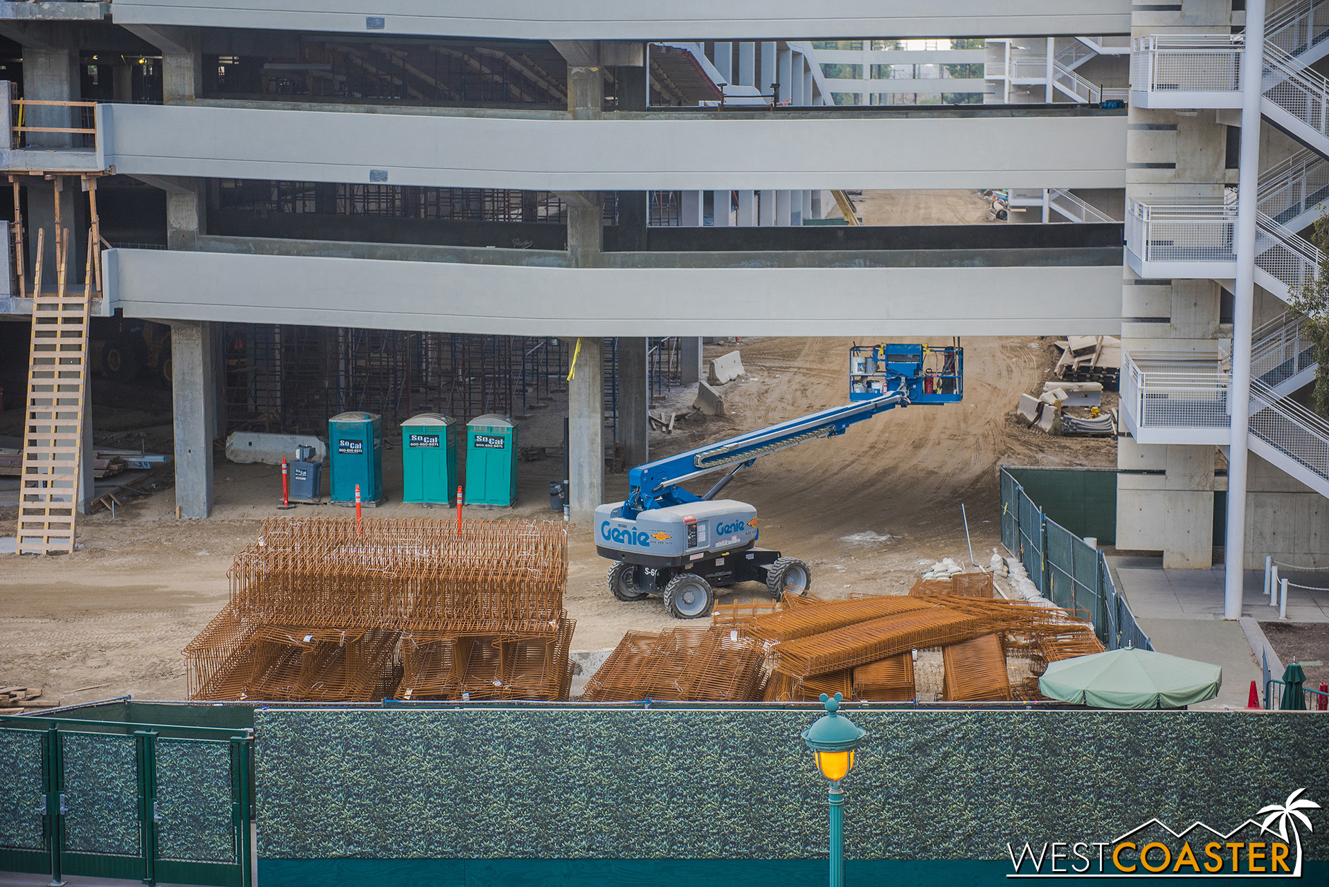"""The concrete is getting """"sacked and patched"""" to cover up blemishes from the formwork."""