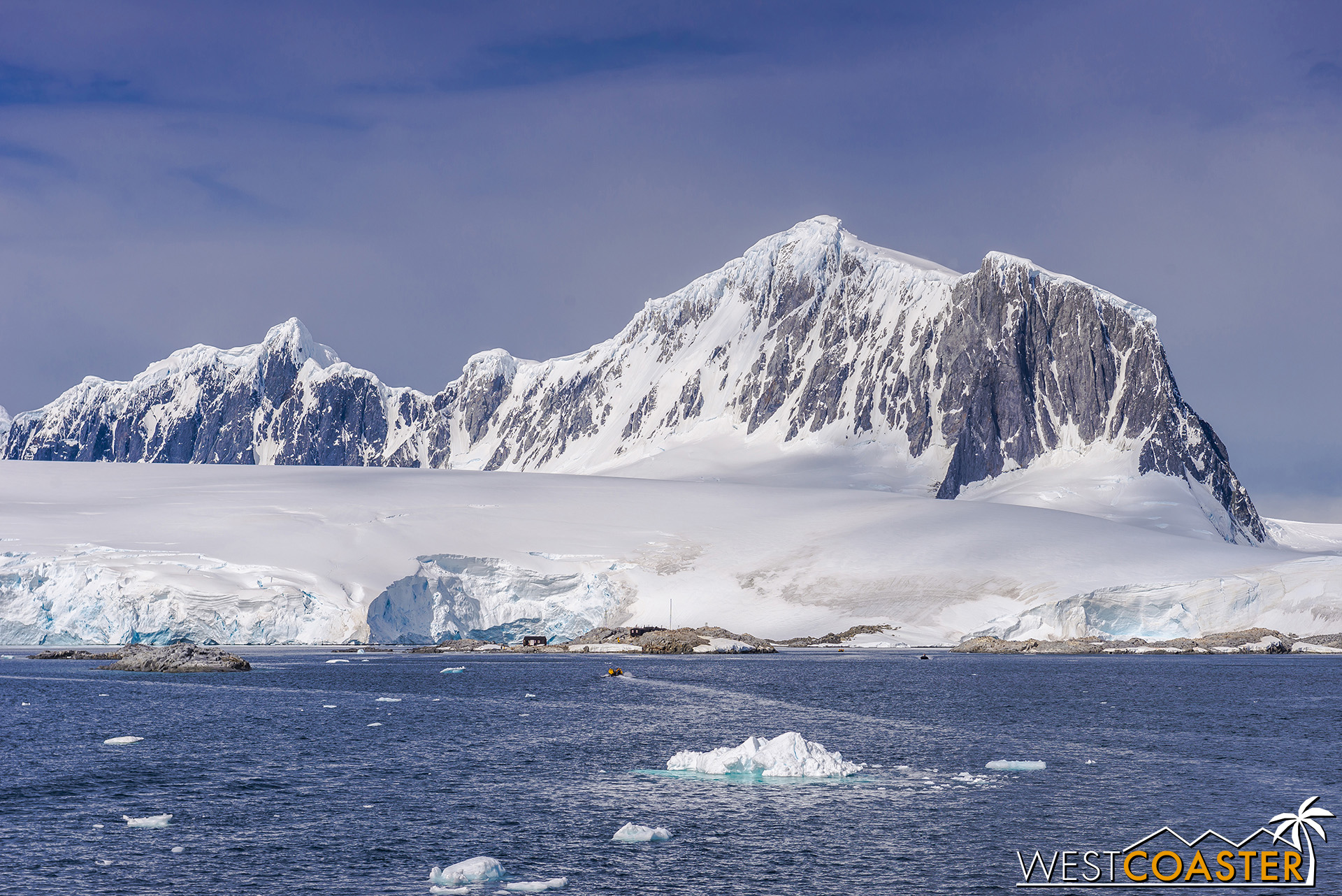 The tiny base at Port Lockroy is dwarfed by the resplendent landscape behind it.