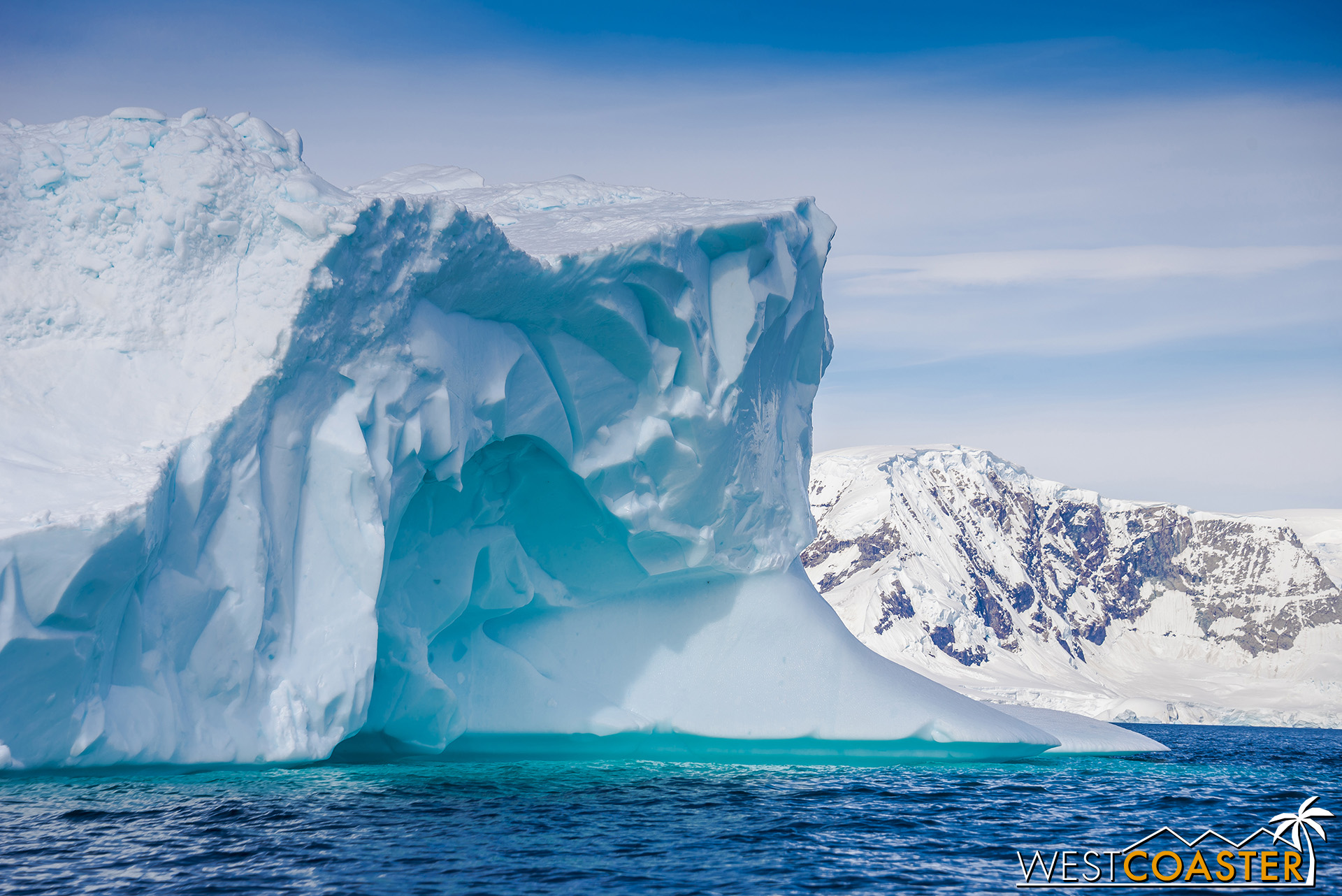 The captivating blue colors and shaped texture of the packed snow and ice are exquisite.