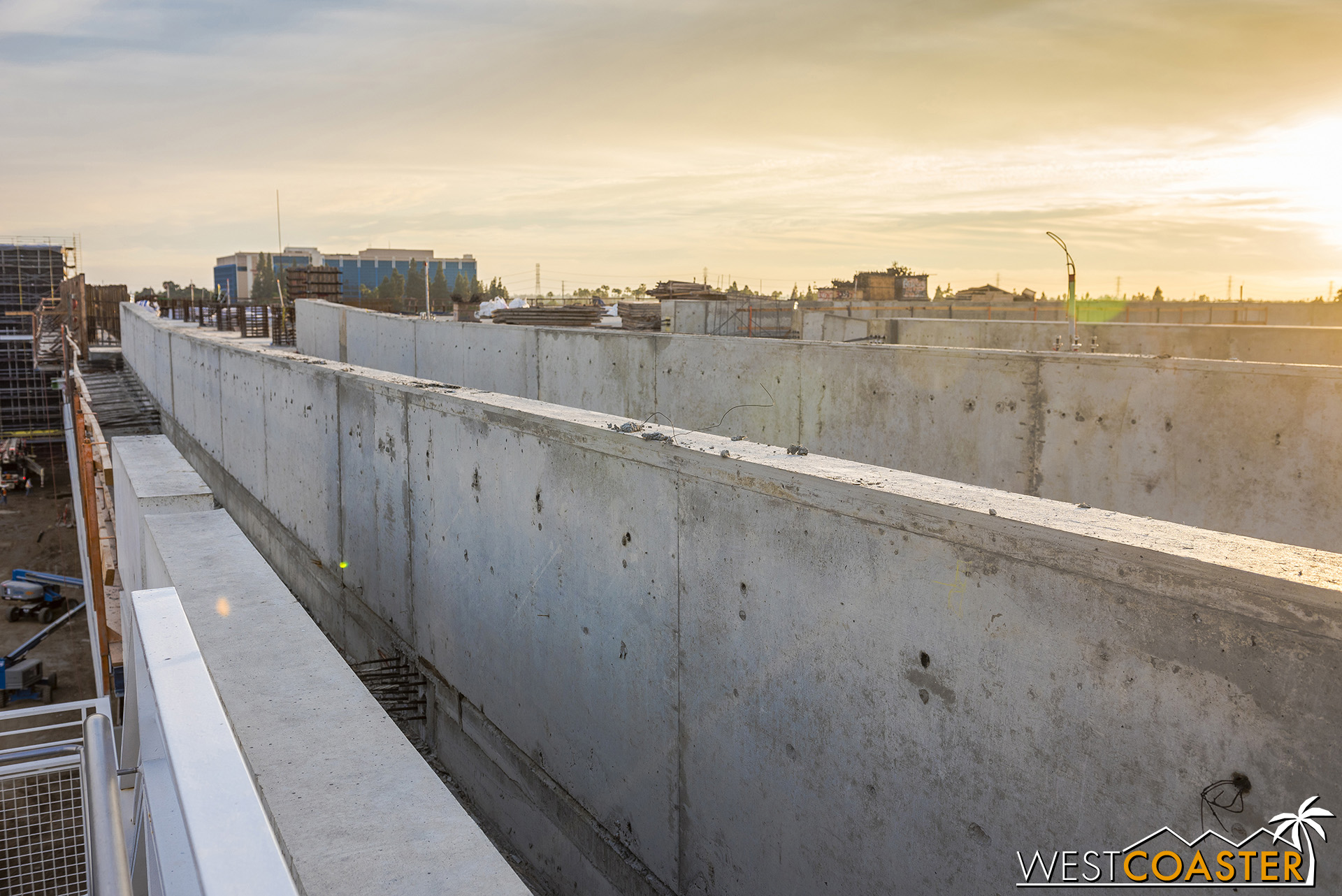 The double set of walls guards the pedestrian path, while another concrete wall on the far right serves as the other vehicular barrier at the side of the bridge.