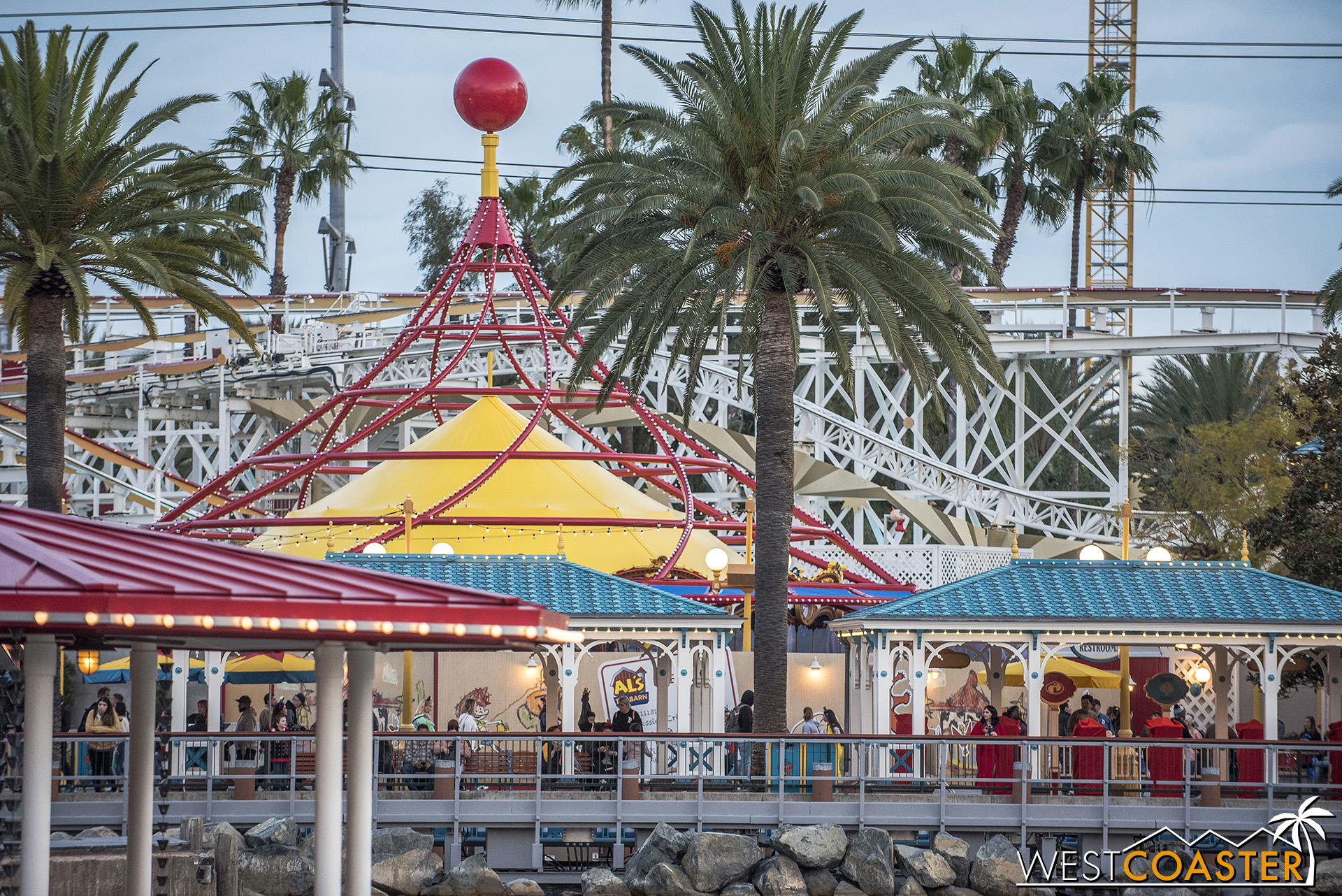 The roofs elsewhere in the Toy Story part of Pixar Pier are turquoise.  So what do they paint the top of Jessie's Critter Carousel?  Yellow, of course.  Well, it does go better with the red.