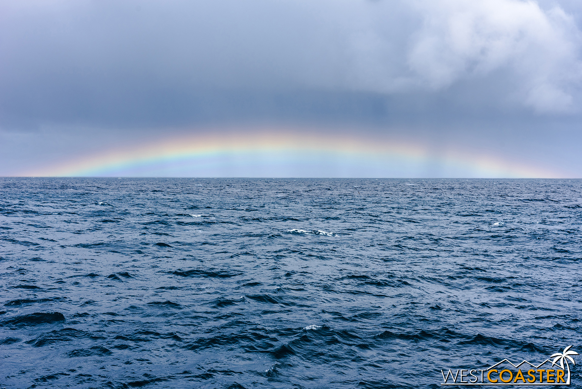 A rainbow at sea—what an amazing sight!