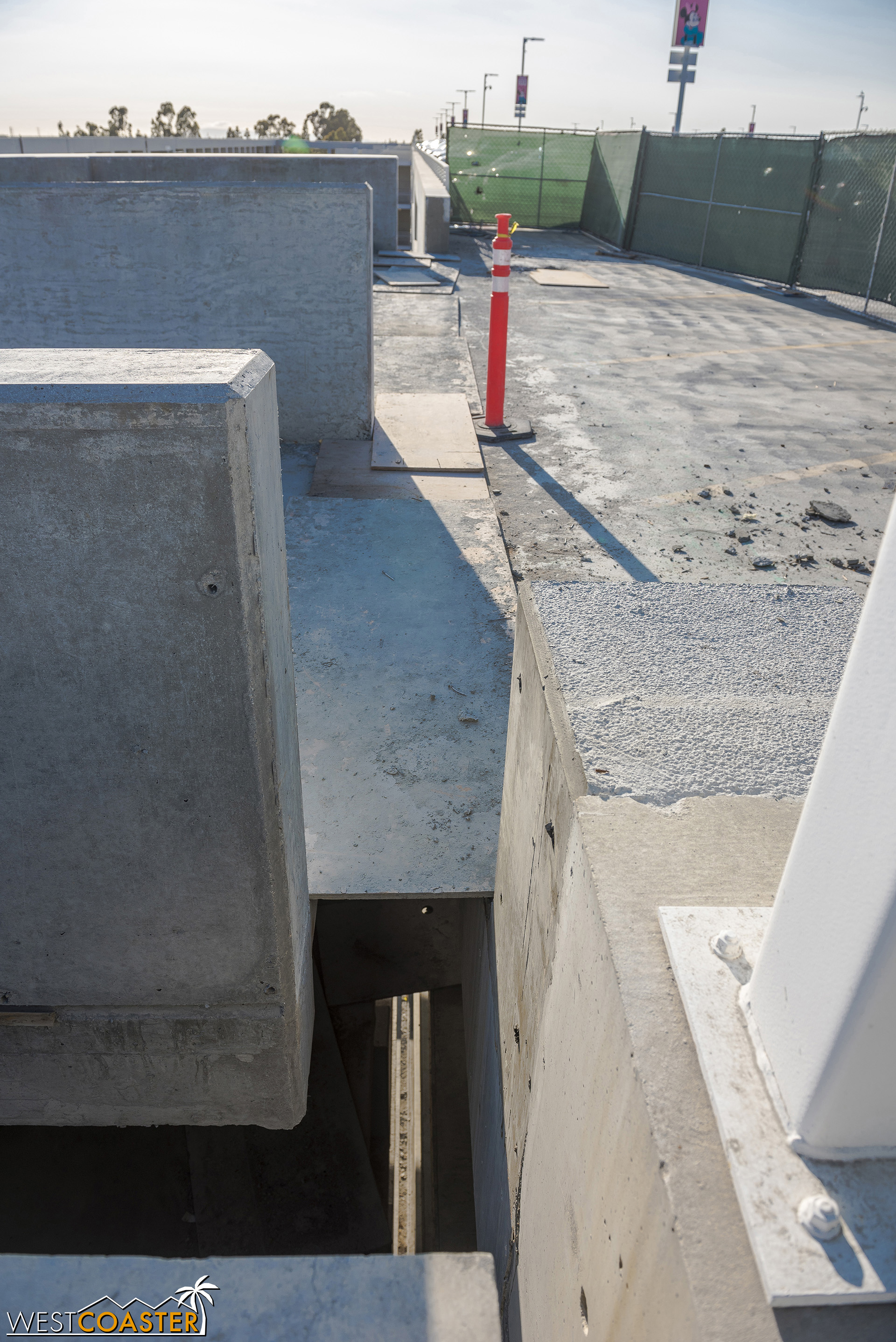 This gap between the bridge connecting the new structure to the old and the existing deck will be filled in with an expansion joint to allow for movement between the two structures.  It's an earthquake accommodation thing.