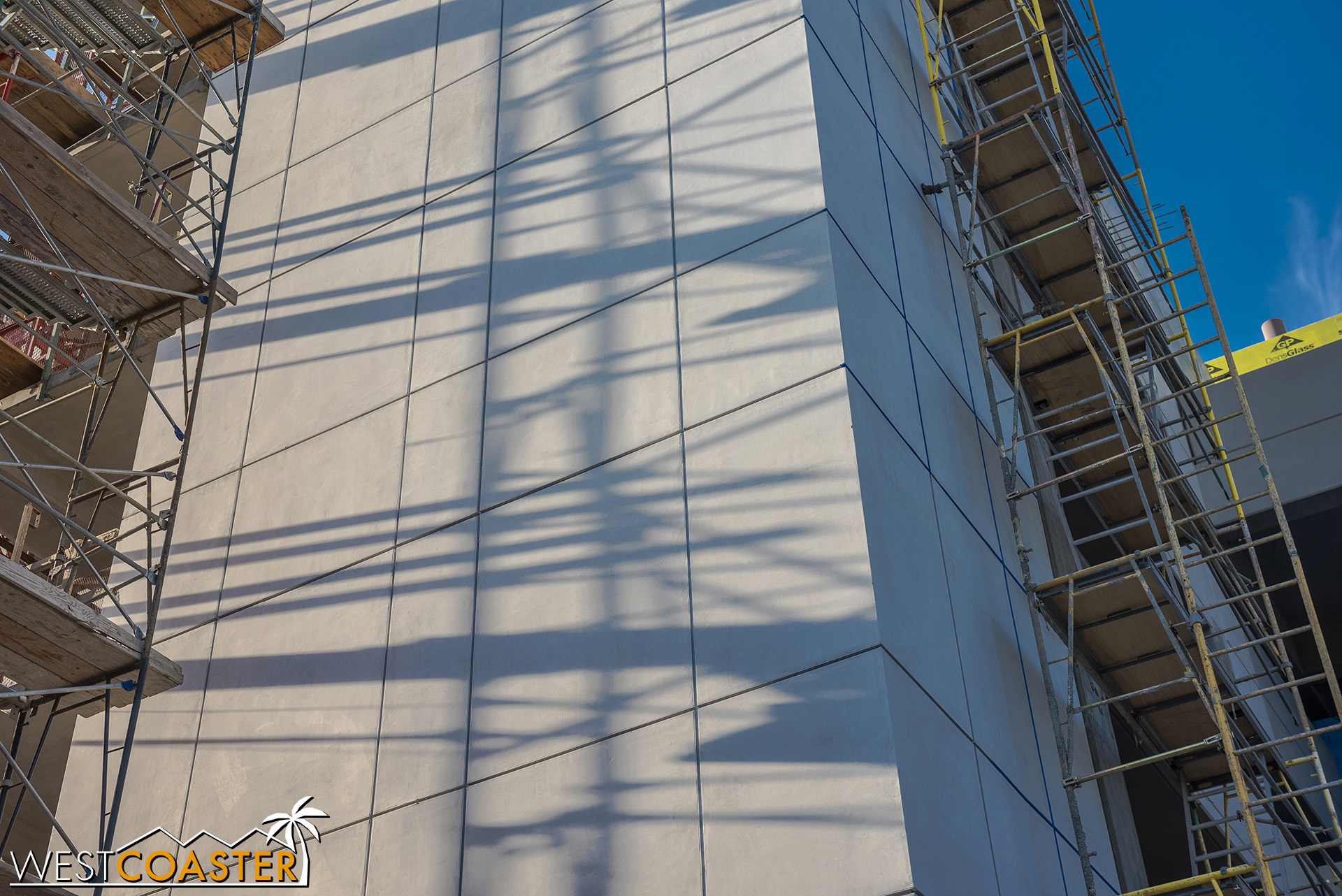 Here's a close-up at the plaster finish of the elevator towers, instead of the metal panel finish that the current structure has.  Money cuts!