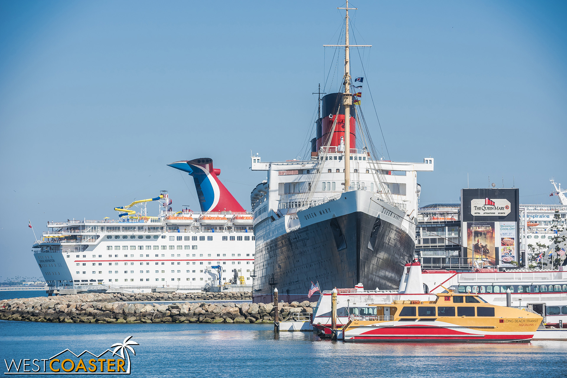 A permanently docked steam liner in front of a soon-to-depart cruise ship.