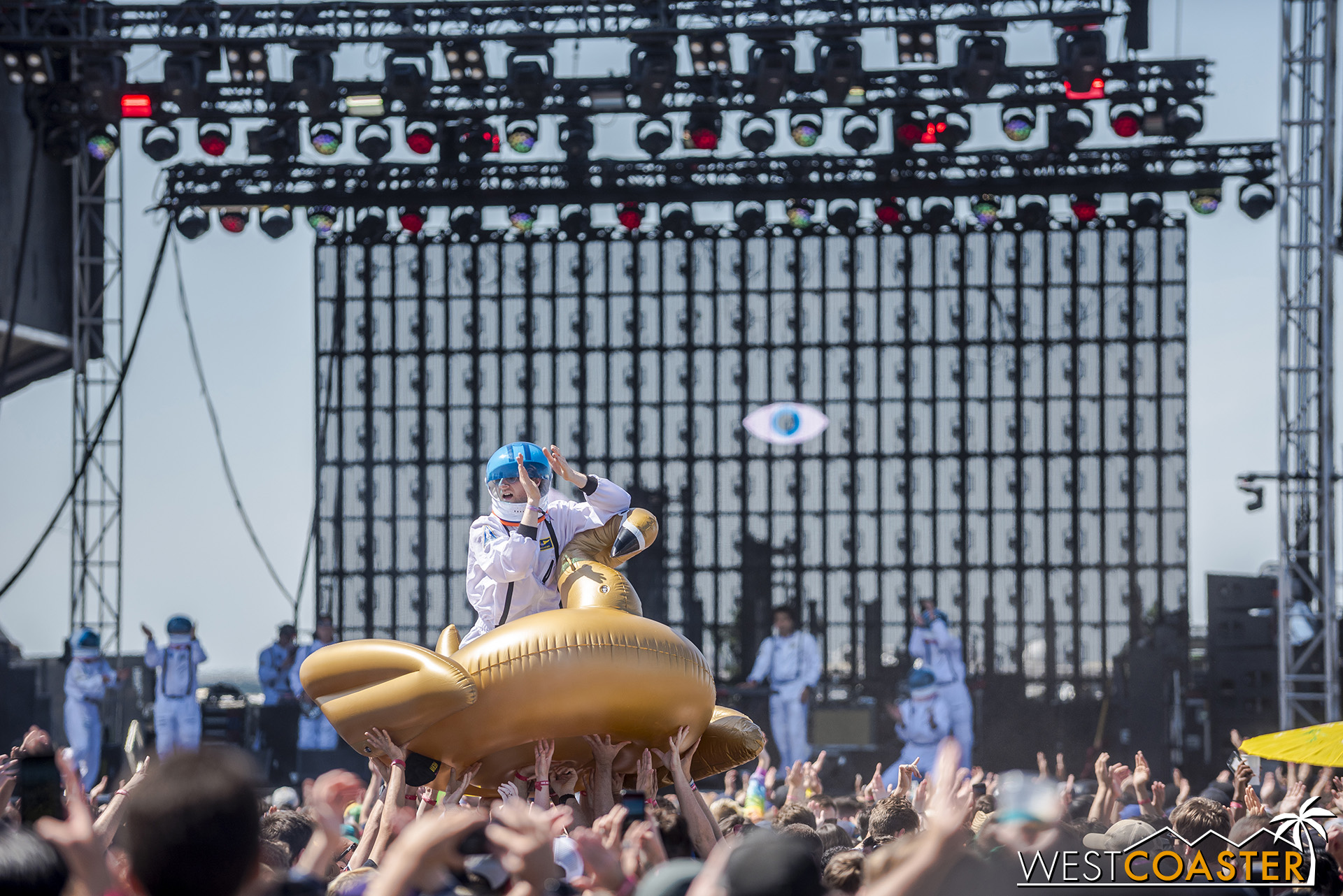 An astronaut golden dragon surfs the crowd during STRFKR's set.