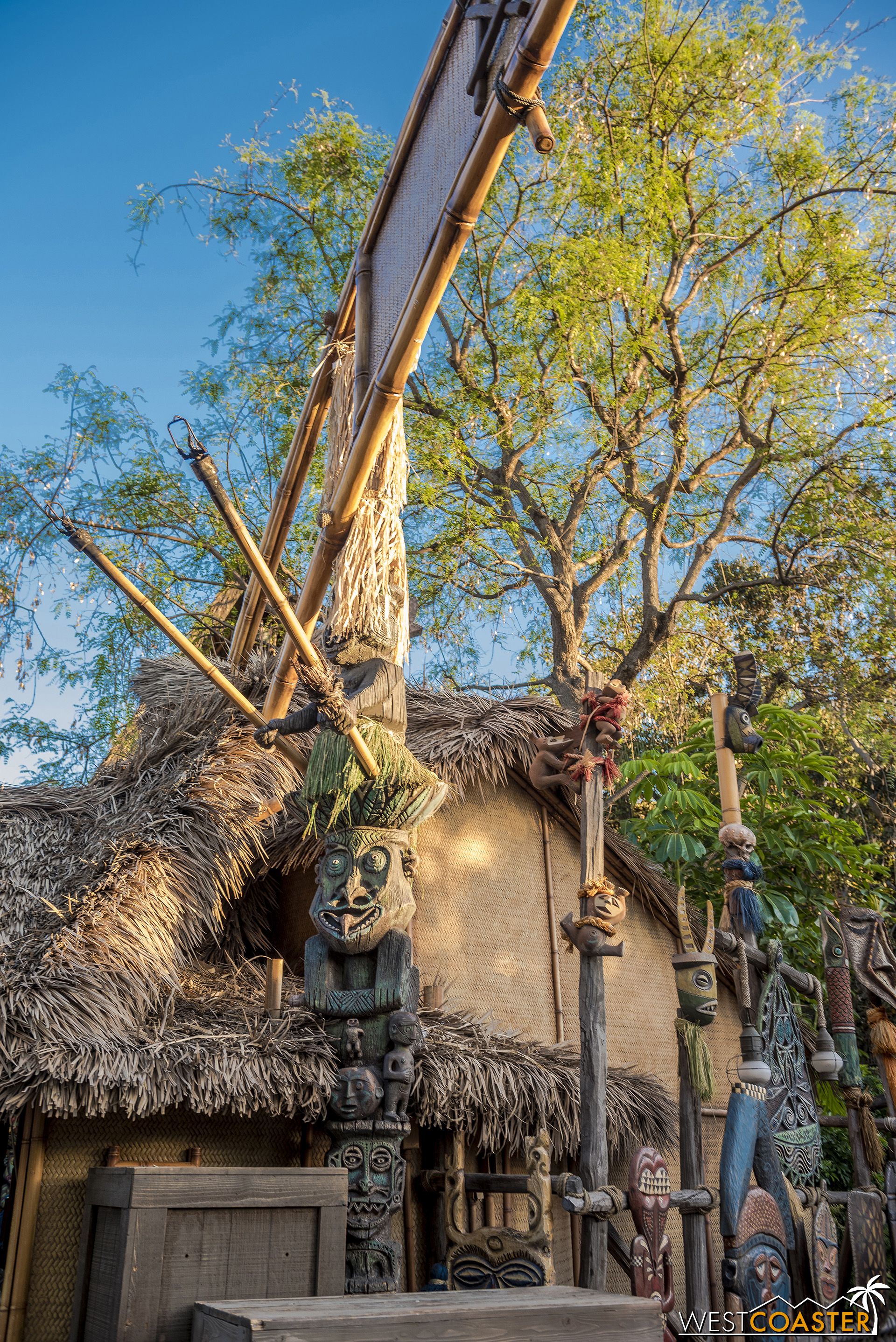 The sign post is integrated into the tiki statues on the Tiki Room side.