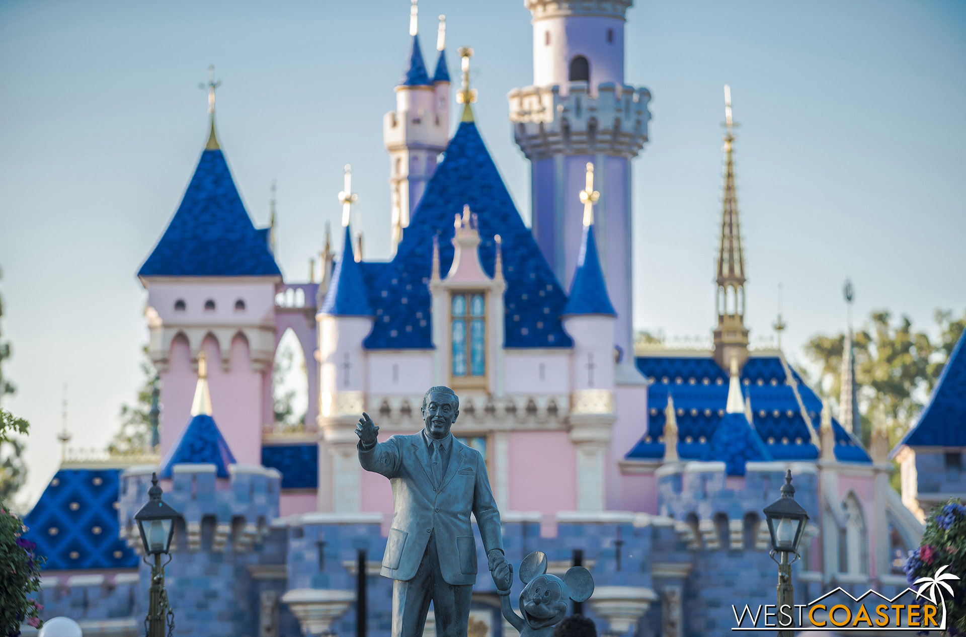 Walt and Mickey say 'hi' in front of the newly refurbished Sleeping Beauty Castle!