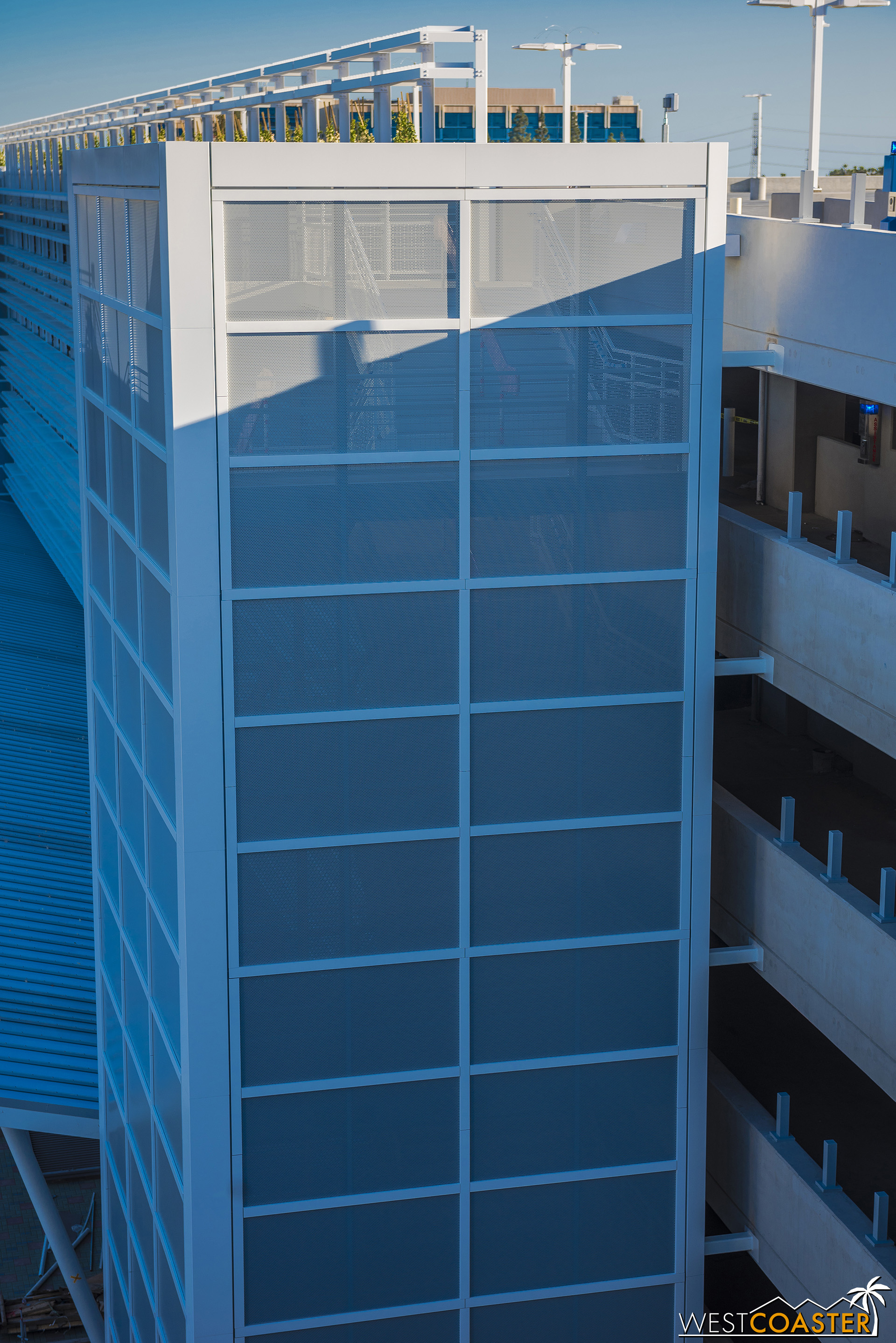 The stairwells have been fully shrouded in perforated metal panels.
