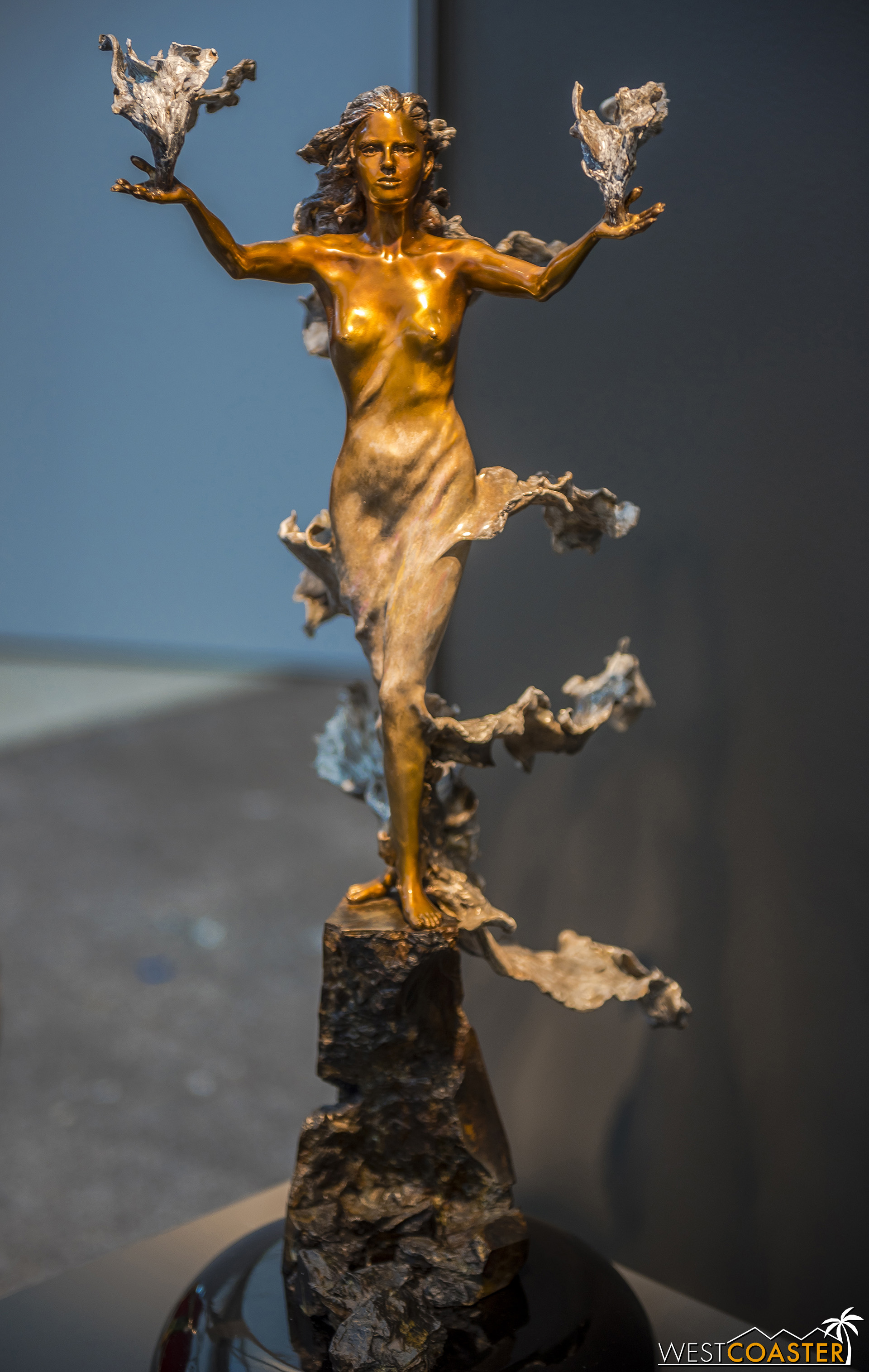 The smoothness and sleek forms of the human body are juxtaposed by the craggy, rocky roughness of the base, which is also made out of bronze despite looking much different!