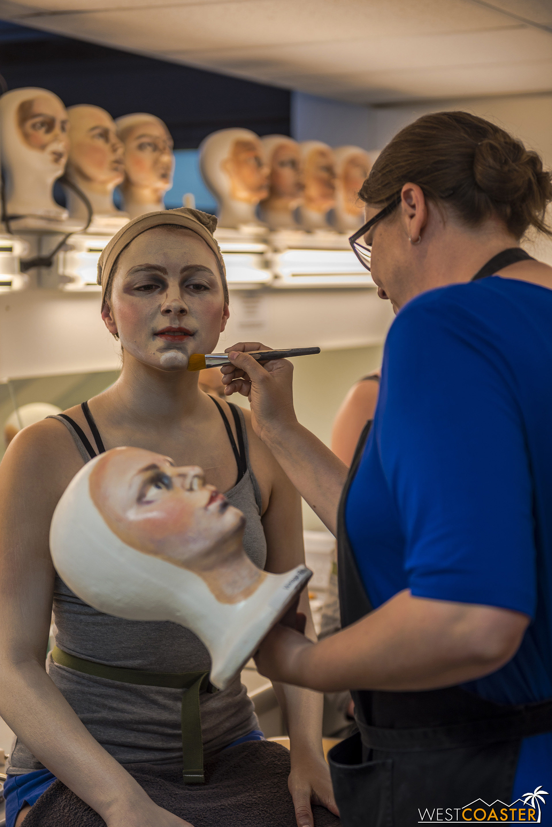 The artists apply makeup on model heads for additional reference, to hone efficiency.