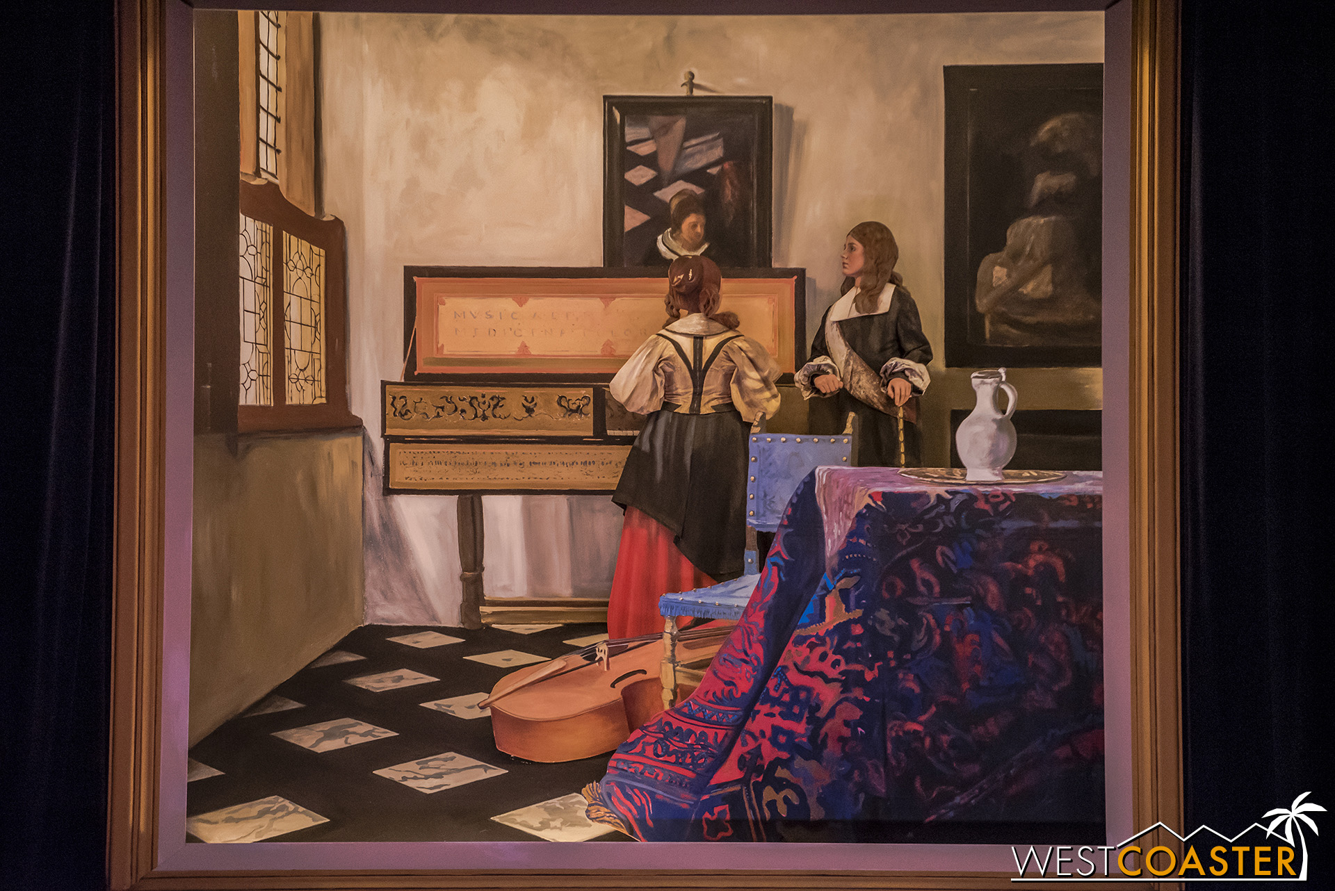 It looks like a flat painting, but those are two live actors and a series of flat components positioned in front and behind to create the illusion of a painting.