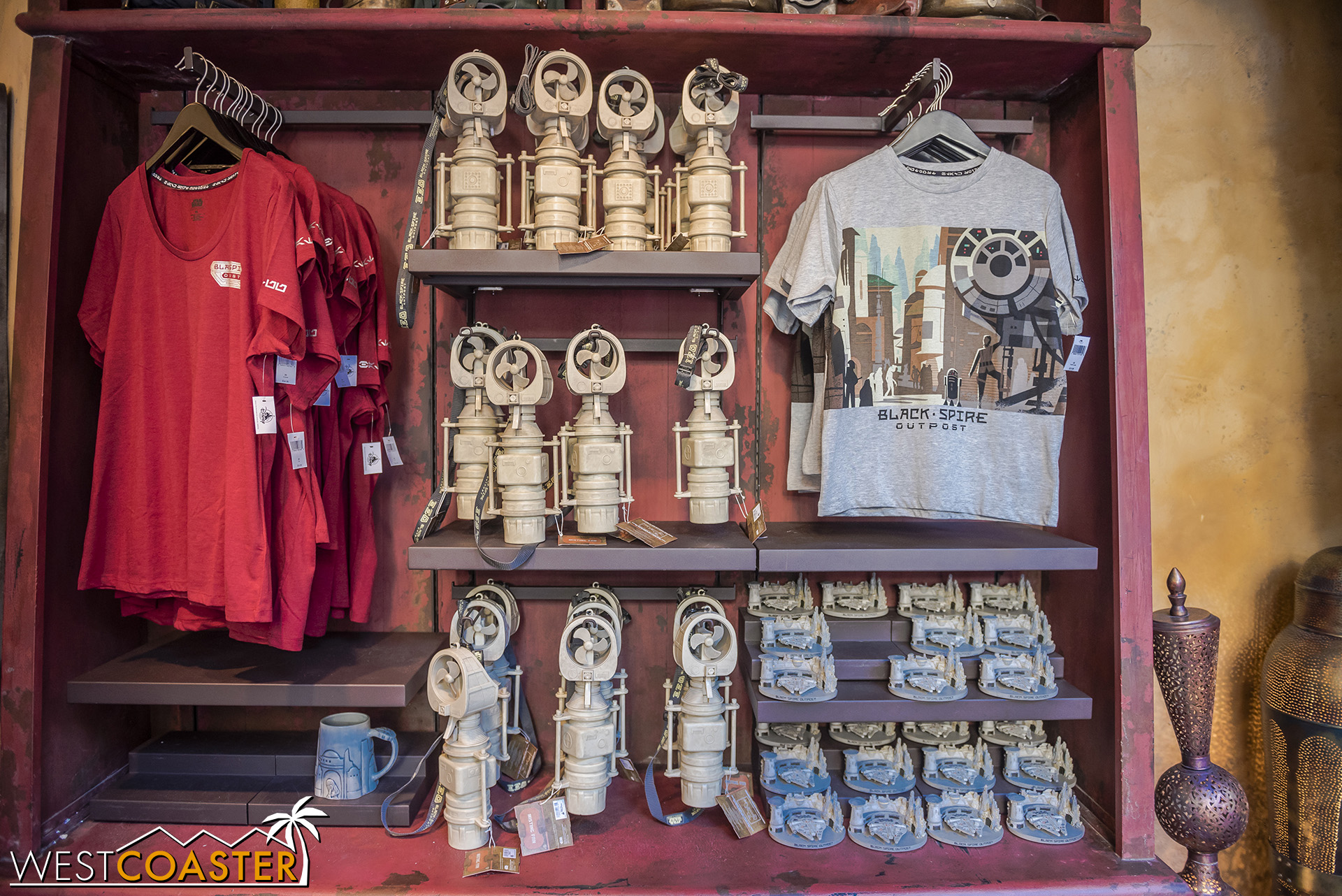 Some merchandise at Jewels of Bith.  The Batuu paperweight ornament on the lower left is pretty neat.
