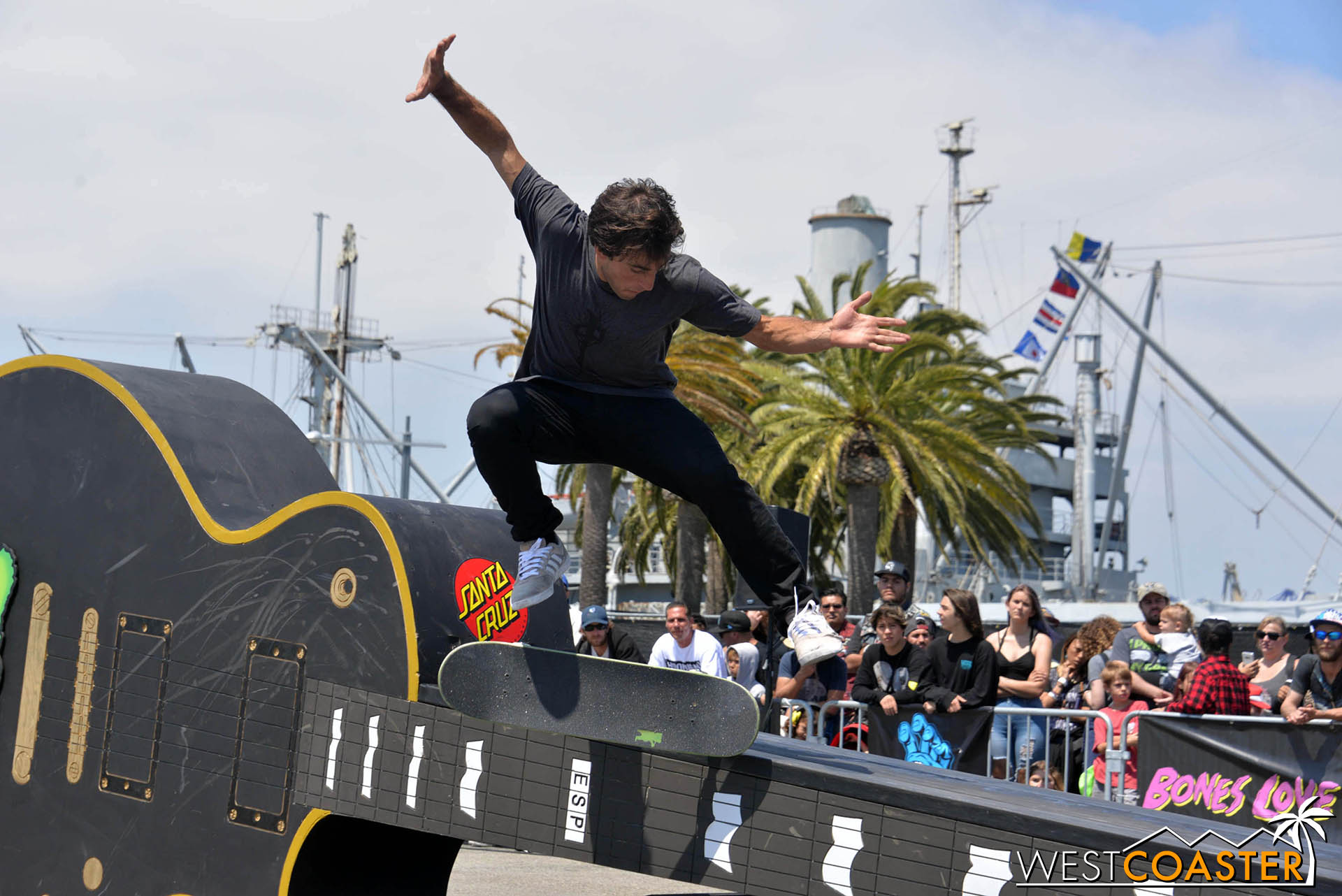 A skateboarder does a trick in the temporary skate park.