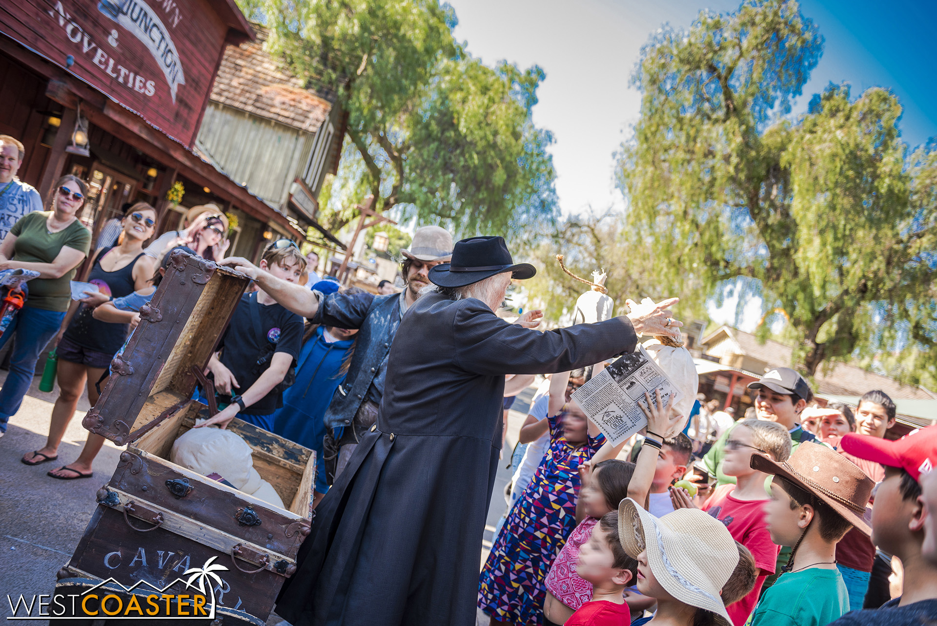 """Meanwhile, Judge Roy Bean checks to make sure the chest actually still contains the town's valuables.  """"What, you don't trust me??"""" asks Clay Mayfield, flabbergasted."""