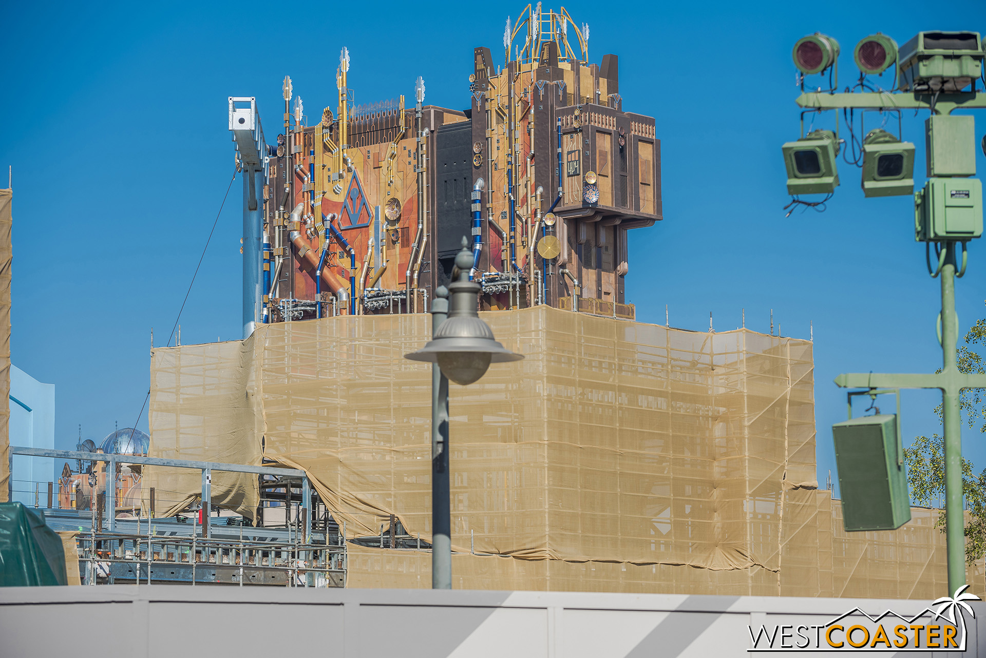 No, they're not surrounding the Guardians tower with scaffolding and tarps.  This is what ya call an optical illusion!