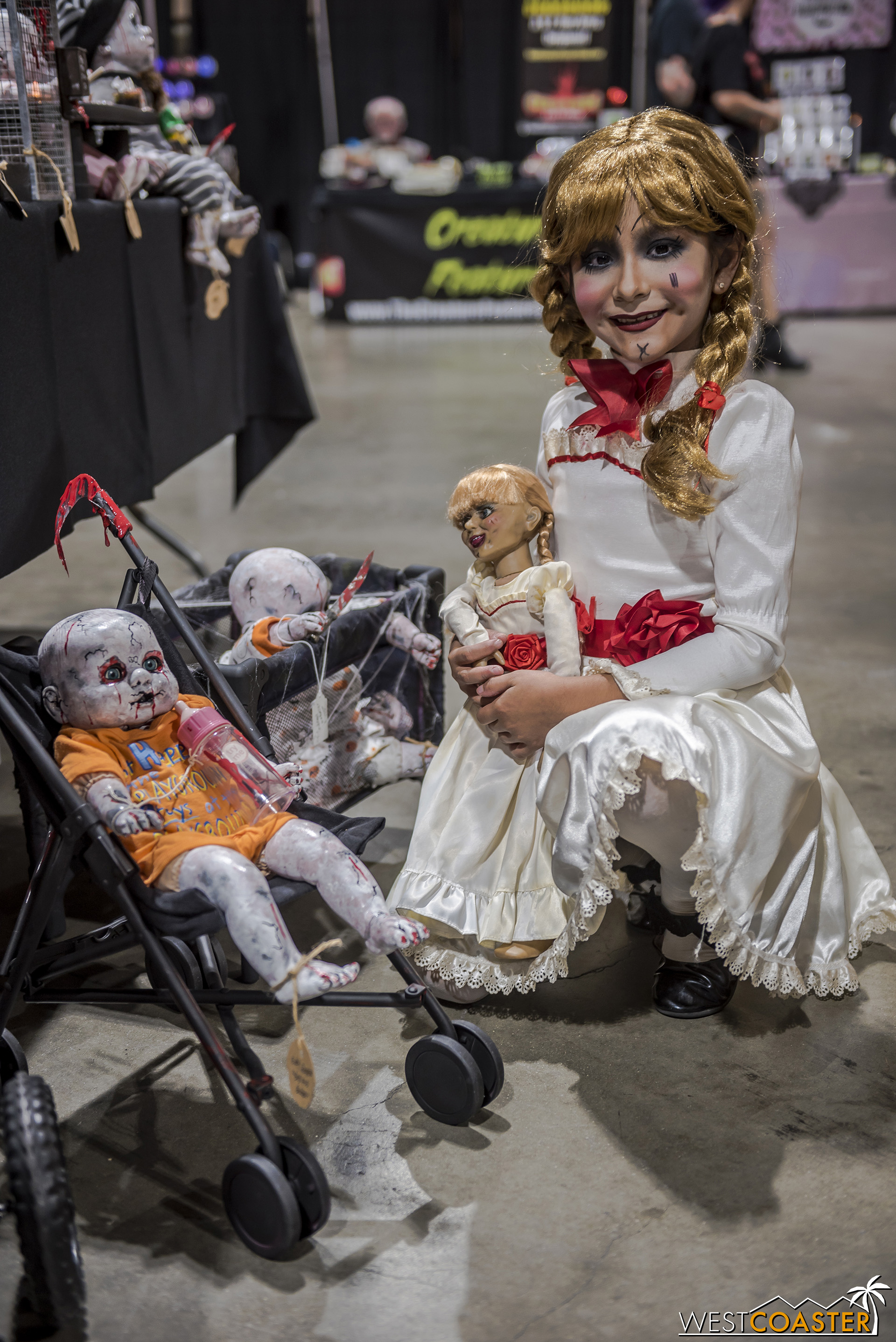 Creepy Cute Jaylah  was at the convention both days, and this interaction with some dead baby dolls was practically perfect with her Annabelle cosplay.