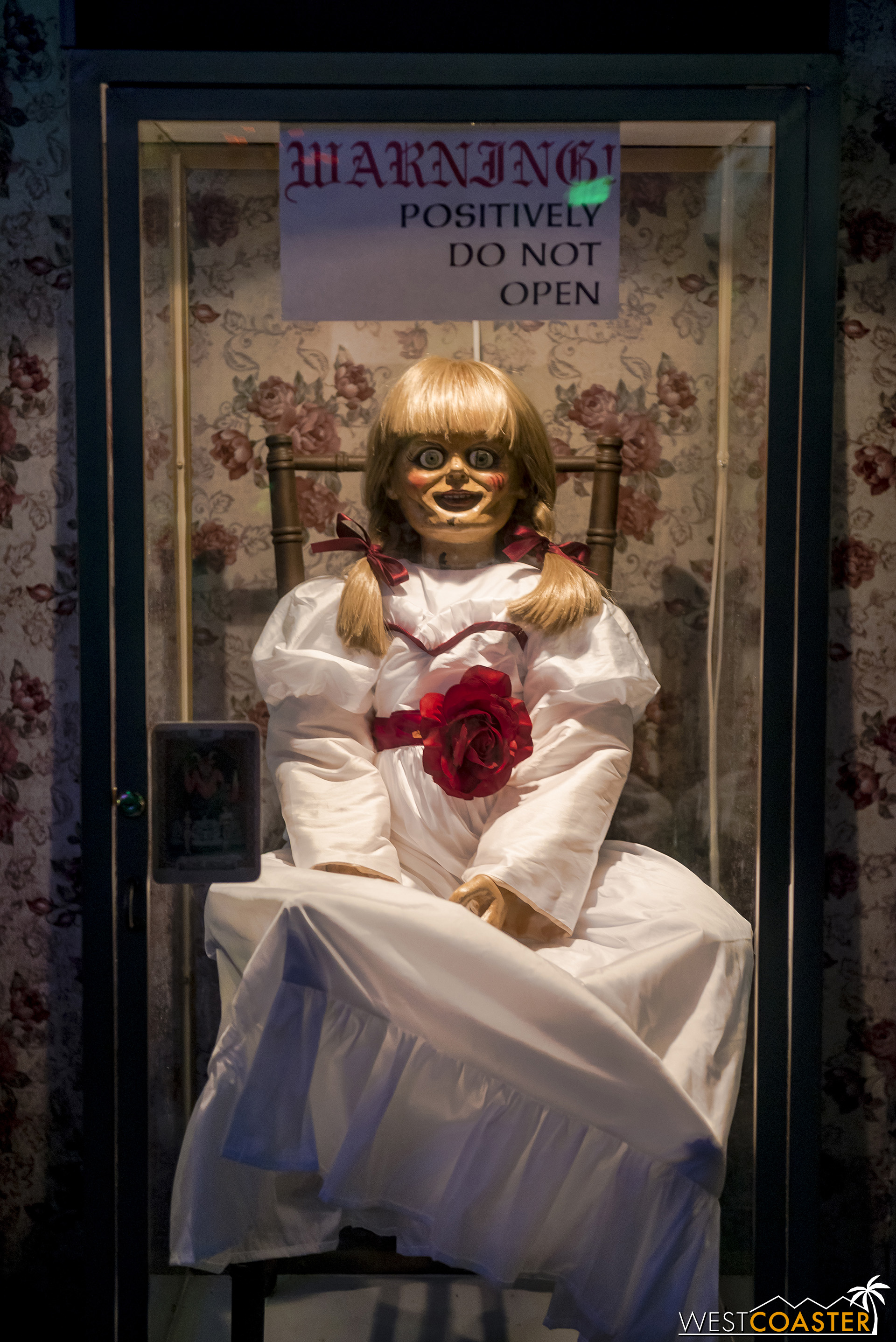 Creepy Annabelle doll.  Or perhaps Alcoholic Annabelle in this setting.