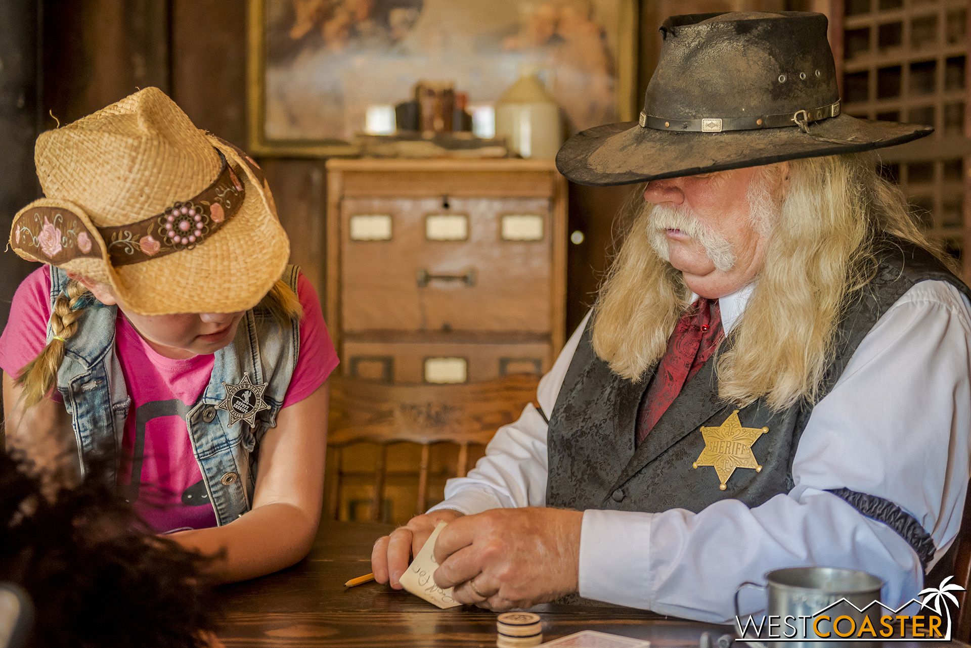 In the Sheriff's office, guests can always join in a card game.