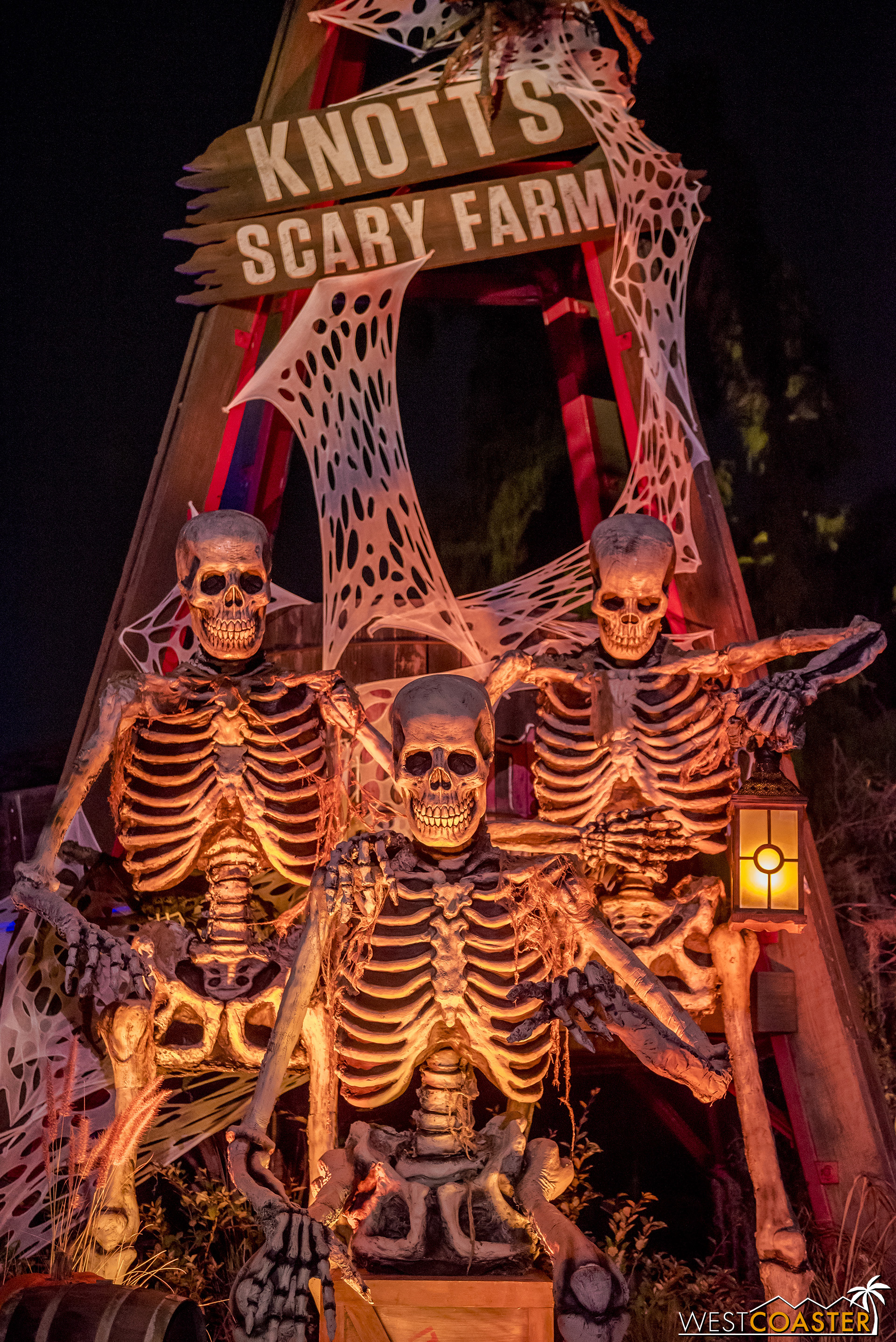 Giant skeletons look on under the shadow of the windmill.