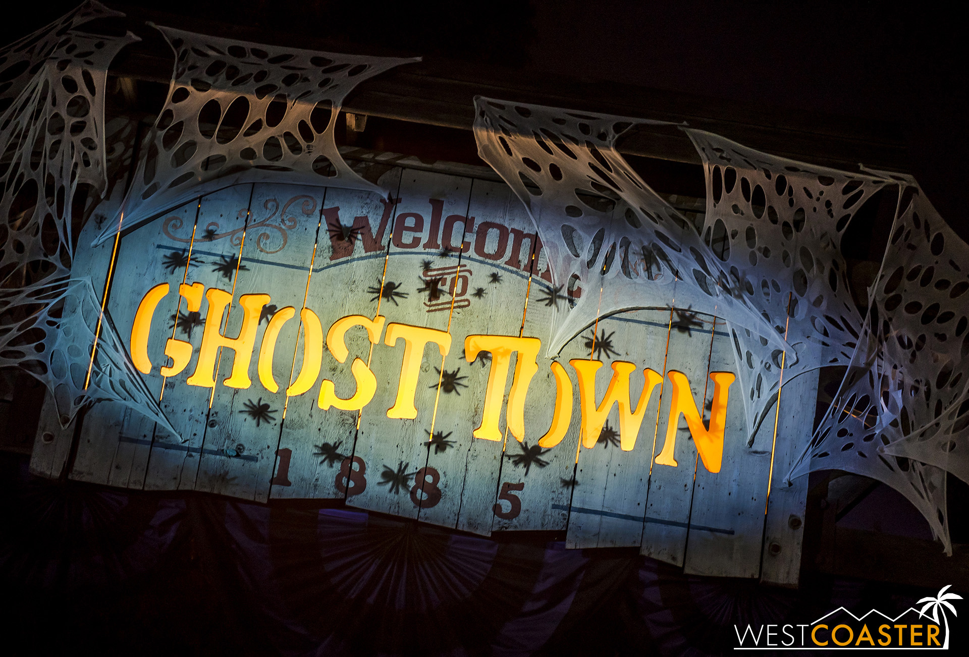 The Ghost Town sign has some new creepy crawly projections this year.