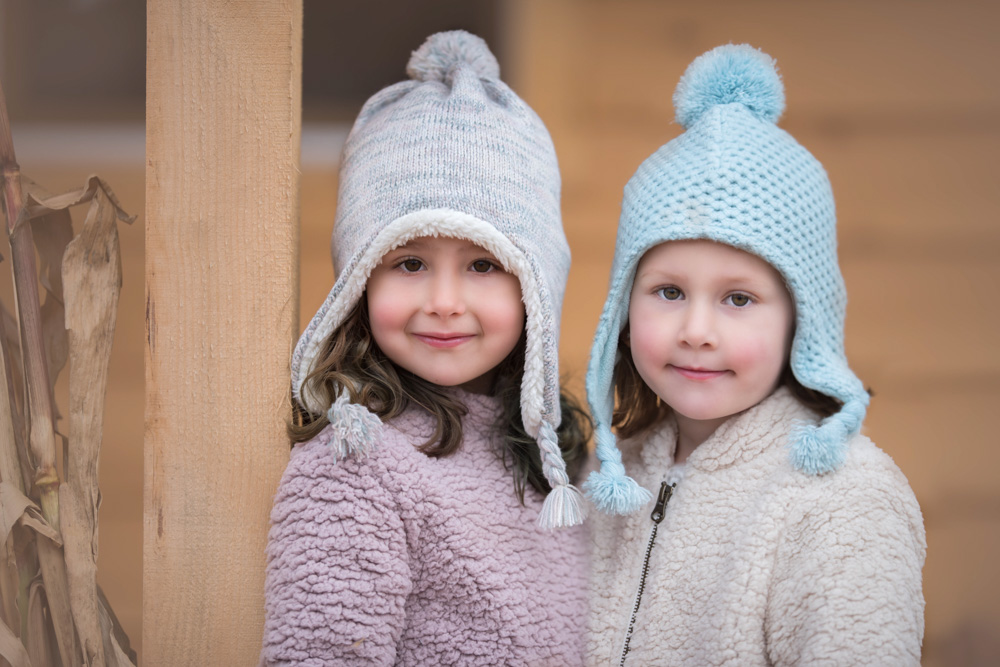 Stunning two sisters posing for the camera during styled family