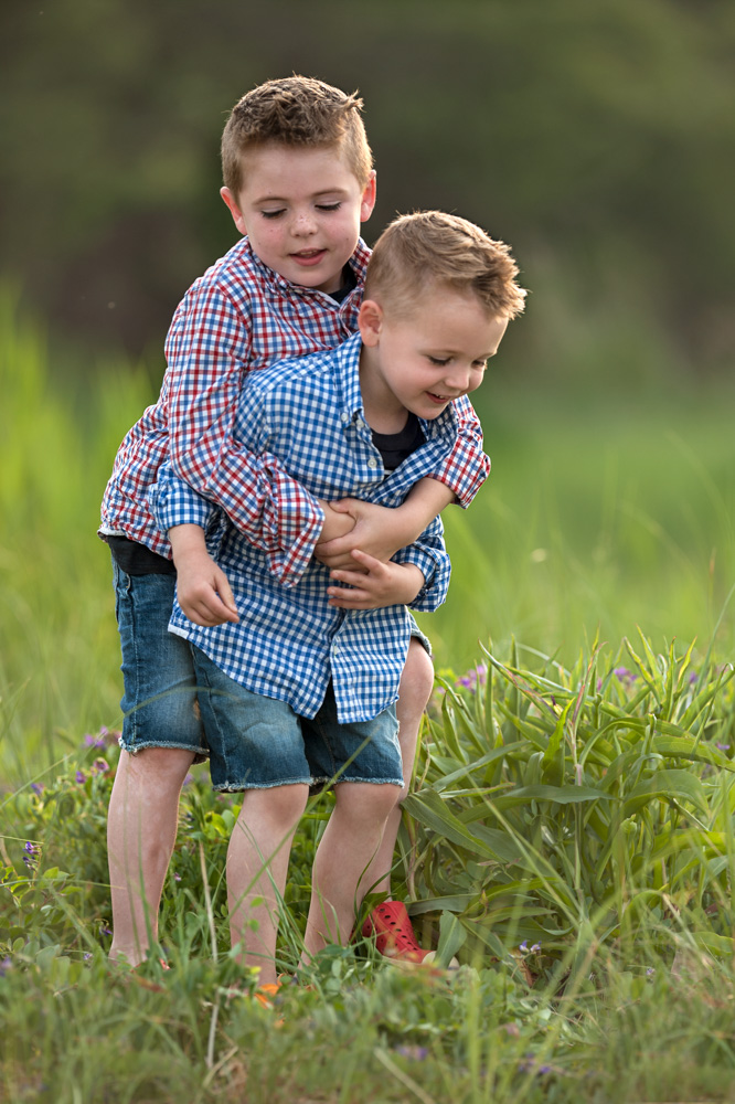 Boys playing around during a family photo session in plymouth ma