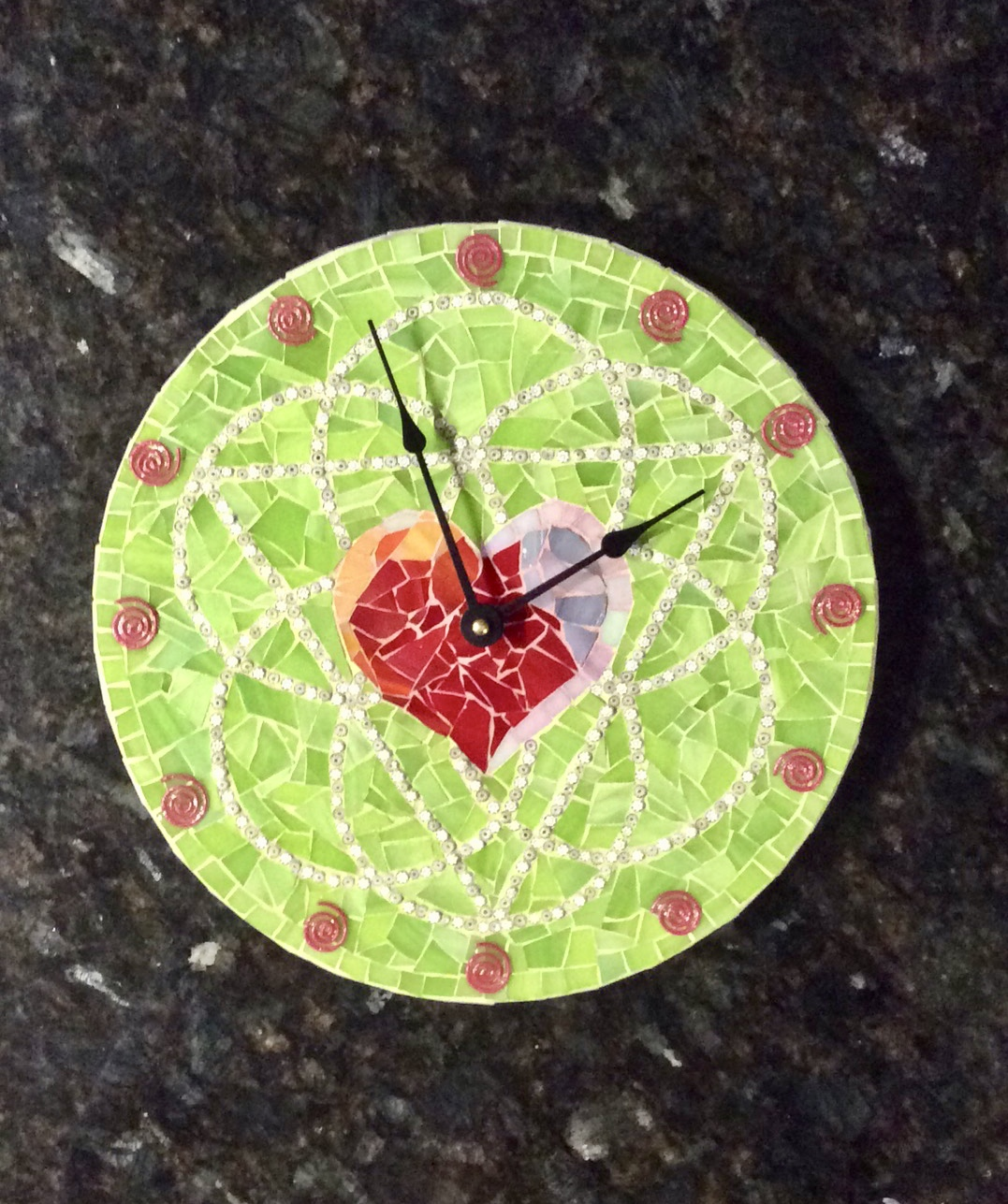 The is a clock designed around the book cover. It was a gift to a friend of mine who just published her first book.