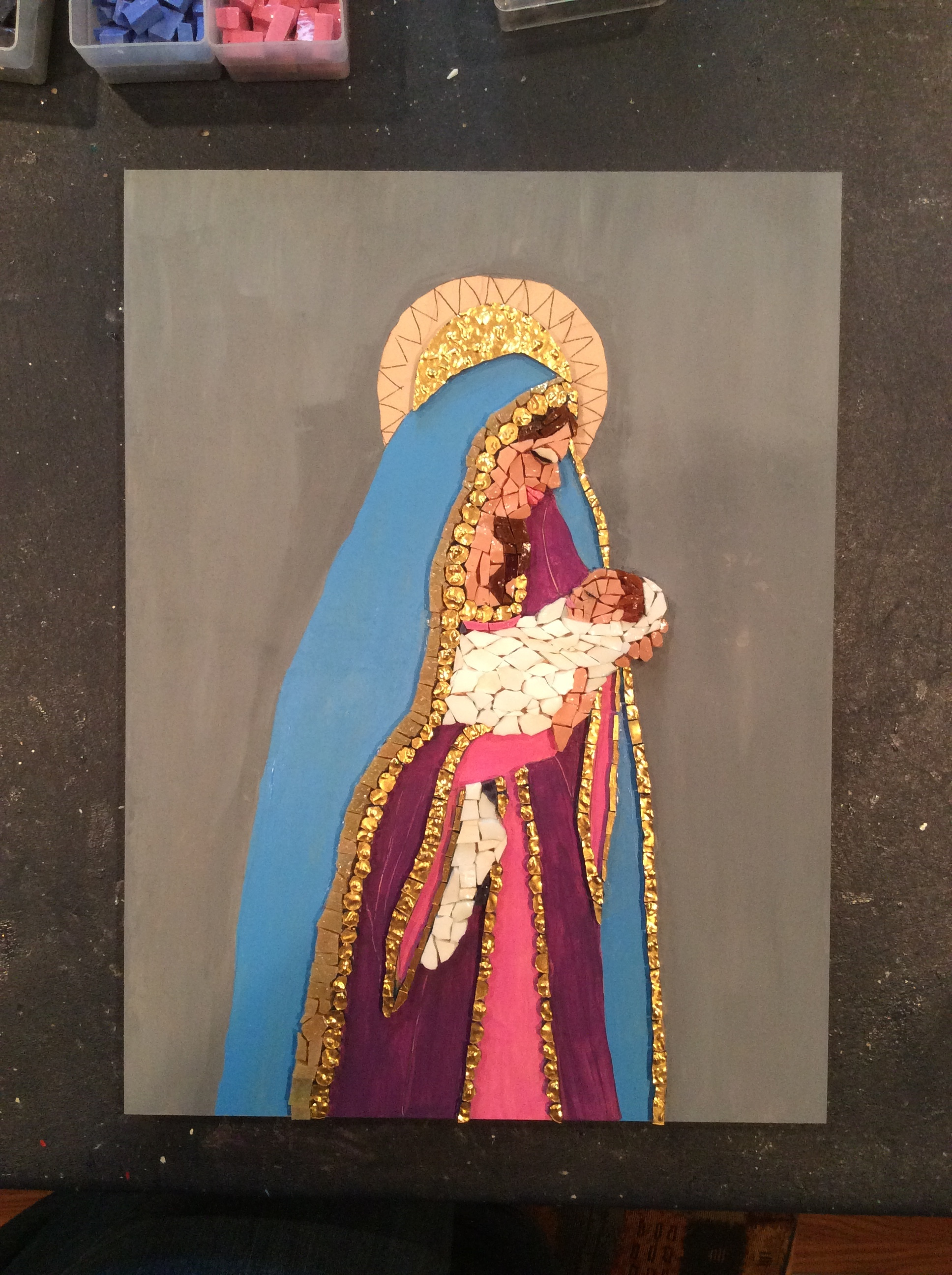 "Cutting  Halo was a real challenge because I wanted it to be one piece. After I started the piece I realized I hadn't painted the artboard gray as I had in the past. Thought a bit and painted the cartoon drawing which was how I was taught by Gina Hubler. My Hubby says I should call the piece "" Birth of a Pope""  because the babe looks like he has a little white hat on.   I worked 2 hours setting the first babe face. Chipped it out and redone with 4 hours of work but that includes the blanket."