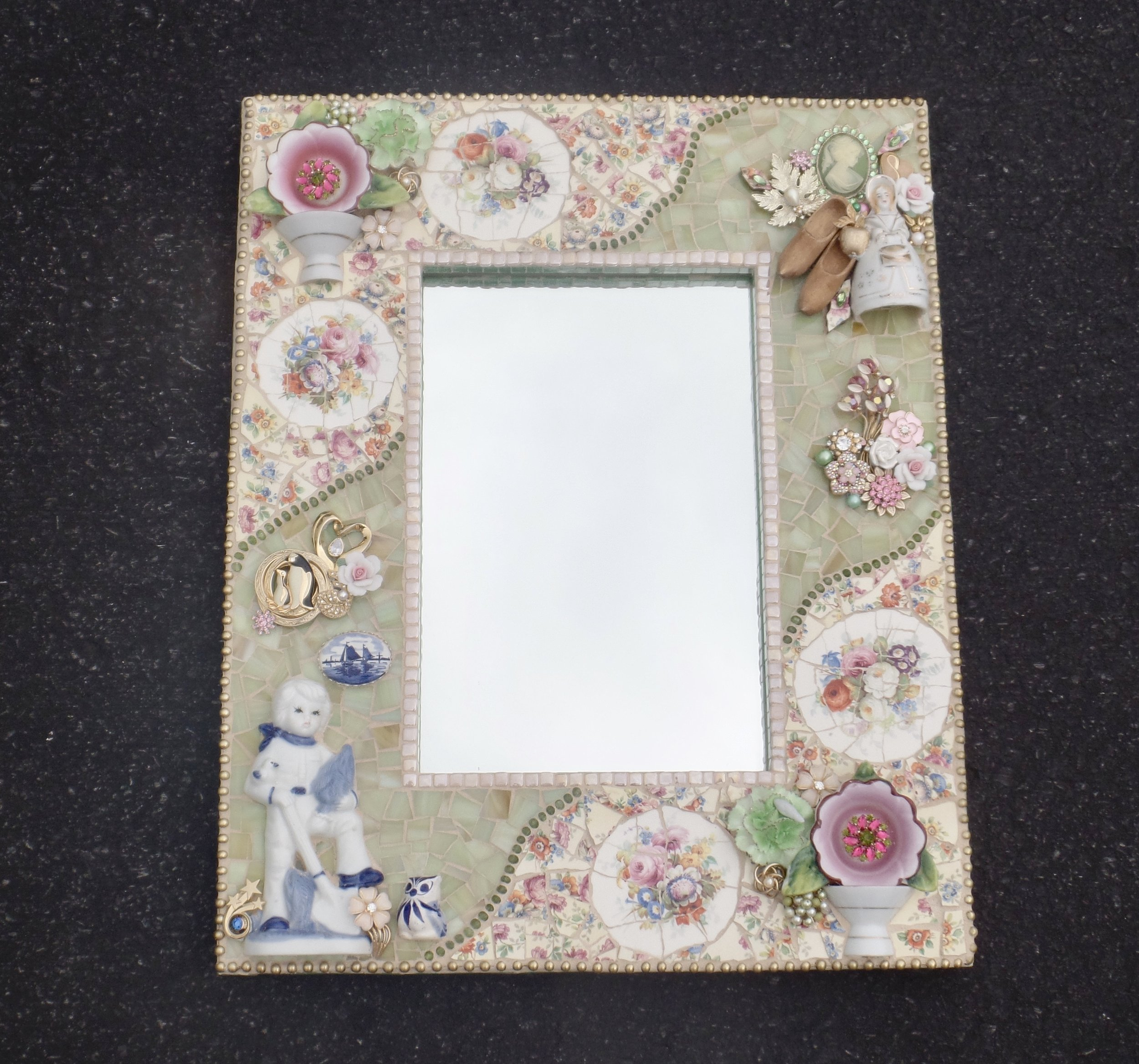 I just completed this story mirror from found objects I had in my studio.